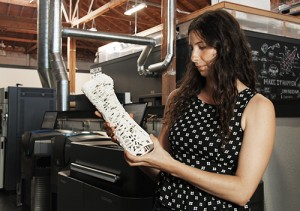 Industrial Designer, Ava DeCapri, with the #CAST prototype at FATHOM's Oakland Production Center.
