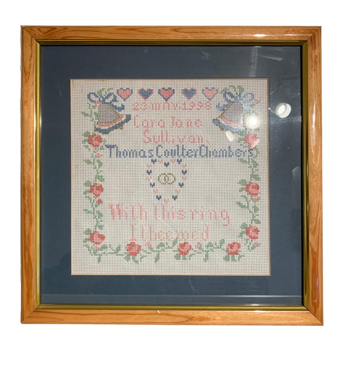 Cross-stitch in original frame