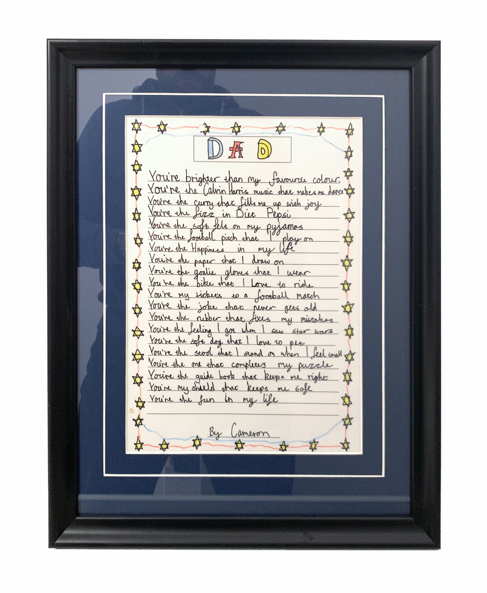 Son's poem framed with single mount with V-groove.