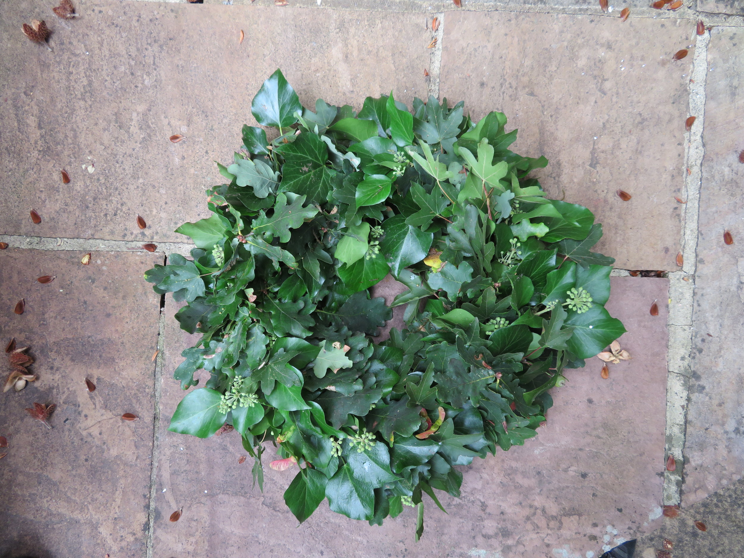 Autumnal foliage covers the moss and provides the 3D shape for the wreath
