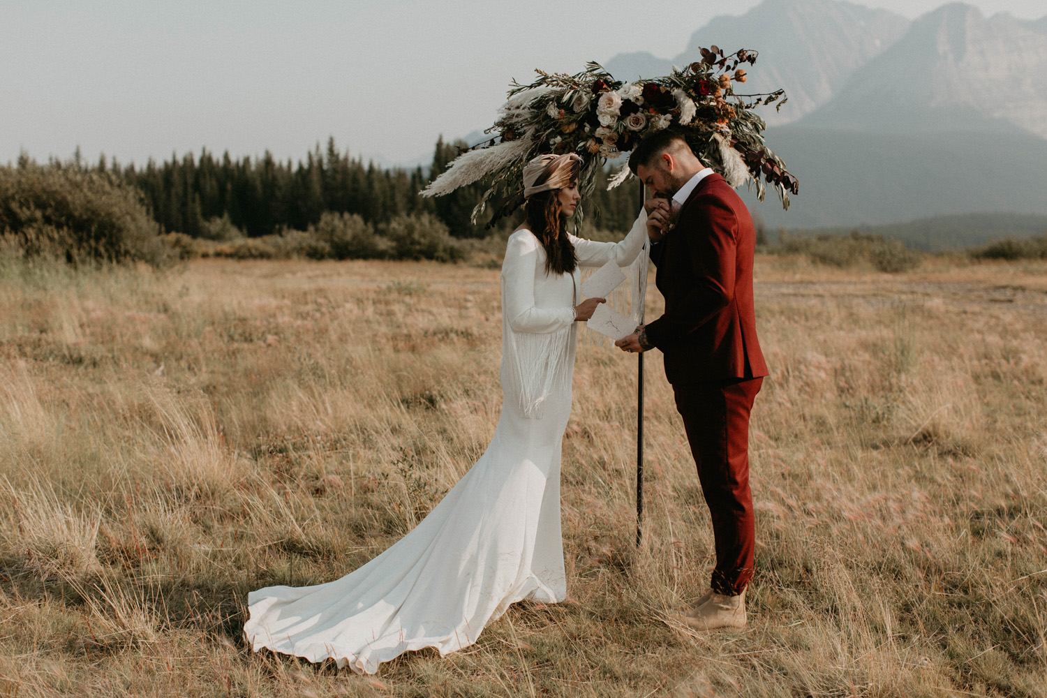 A couple reading vows to one another while eloping in Banff