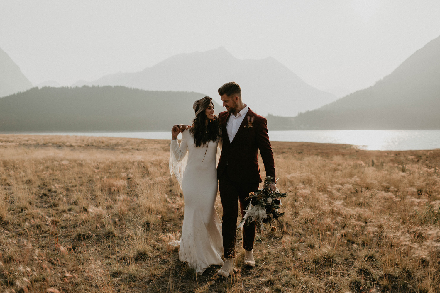 A bride and groom walking in Banff after eloping