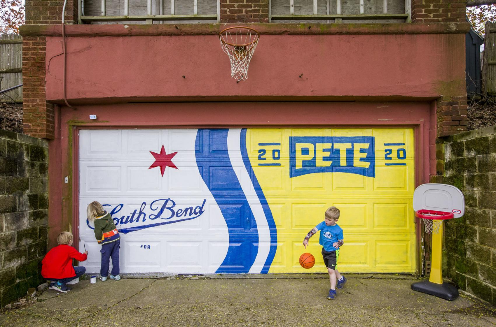 A family in South Bend  decorating their garage with the Pete logo.