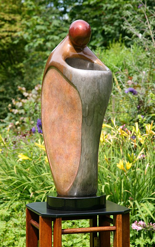 Sharon Spencer - Sharon's passion for carving is the force that fuels her work. Born in Salinas California she began her love affair with carving after becoming dissatisfied with the bureaucracy and predictability of High School teaching. She left security and comfort to begin a transformational journey.Sharon's early work reflected her intense fascination with Native American and Eskimo cultures, affirming her respect for animals and the earth through her figurative sculpture. This thematic thread is constant throughout her work as it evolves into varying scale and different media, which range from large outdoor commissioned abstract pieces to simple, minimalist figurative sculpture.Sharon's art has been featured in Galleries and numerous private collections throughout the United States, Canada, Japan and Europe. She has received countless awards of excellence in juried major exhibitions and shows. Her sculpture captures the fragility of existence, and communicates a joyous affirmation of life, speaking quietly and powerfully to the heart.