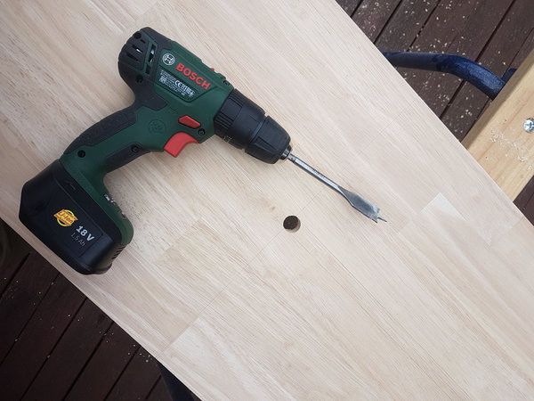 wood with hole and a drill