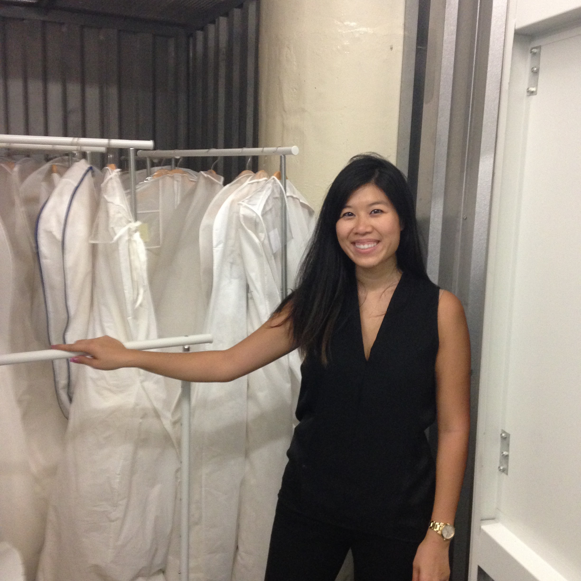 Jacquelyn moving dresses from pop up location to storage facilities.JPG