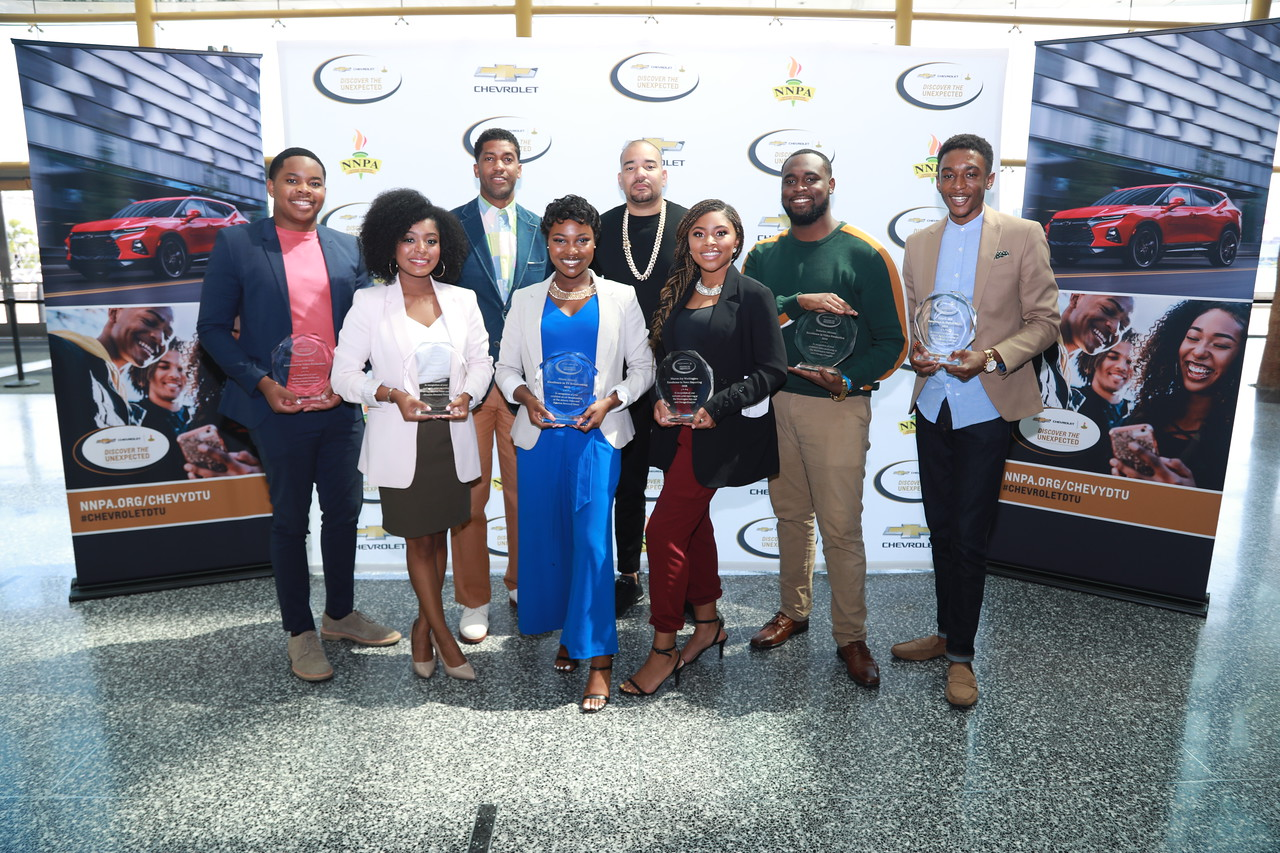 During the Discover the Unexpected Closing Ceremony, Chevrolet awarded six aspiring journalists with $10,000 scholarships and certificates of completion at General Motors World Headquarters. The 2019 DTU fellows included: (left to right): Emani Nichols (Morehouse College), Tyla Barnes (Hampton University), Miana Massey (Howard University), Sharon Joy Washington (Florida A&M), Tedarius Abrams (Bethune-Cookman University) and Elae Hill (North Carolina A&T) pictured alongside the DTU Advisor Fonzworth Bentley and Ambassador DJ Envy. In partnership with the National Newspapers Publishers Association, these fellows embarked on an 8-week road trip to discover and share positive stories within African American communities.