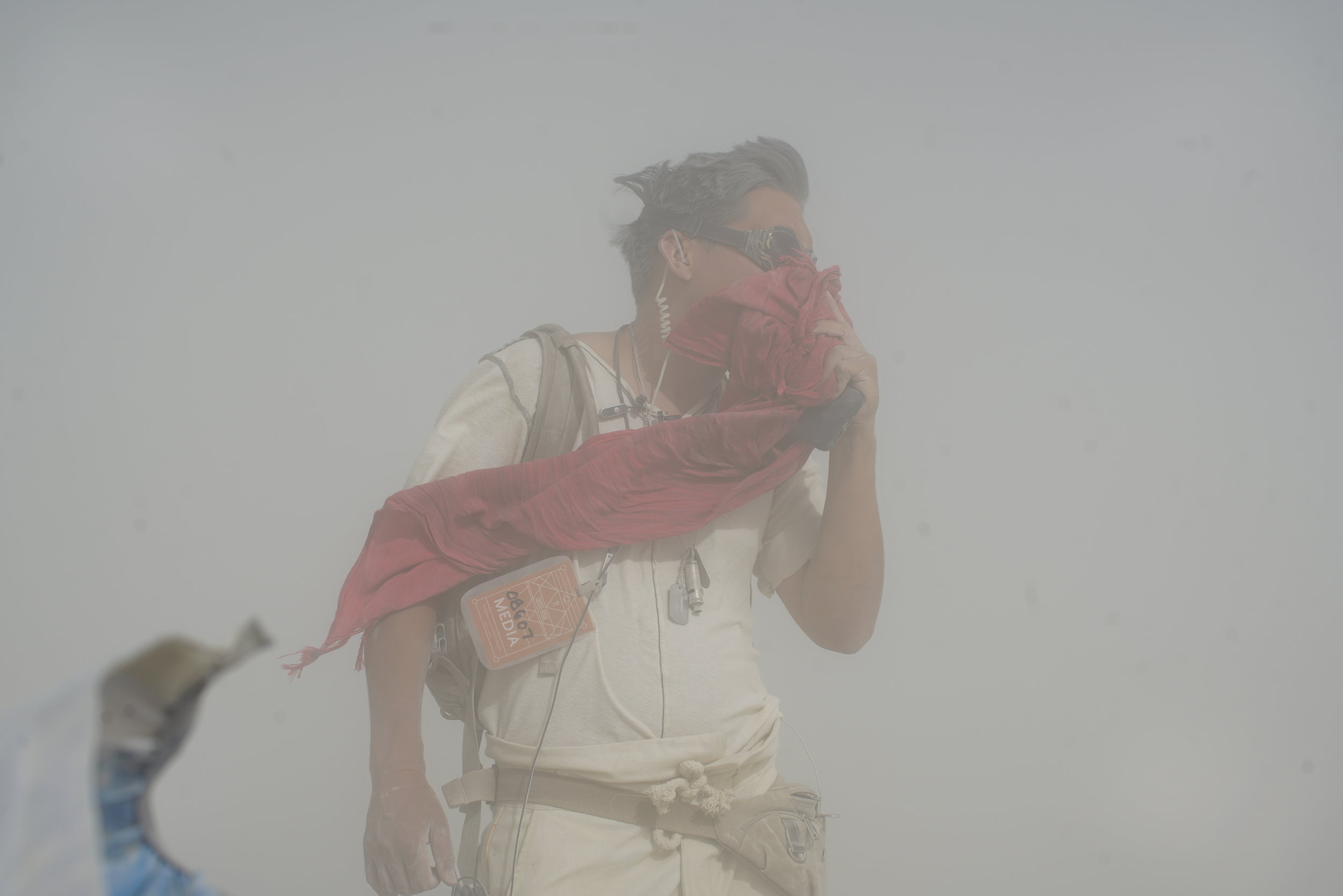 Director/Producer Ryan Moore filming in a sandstorm