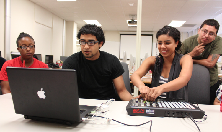 Convergent Media's 1st Student President, Christian Rios, demonstrates Ableton LIve to his peers
