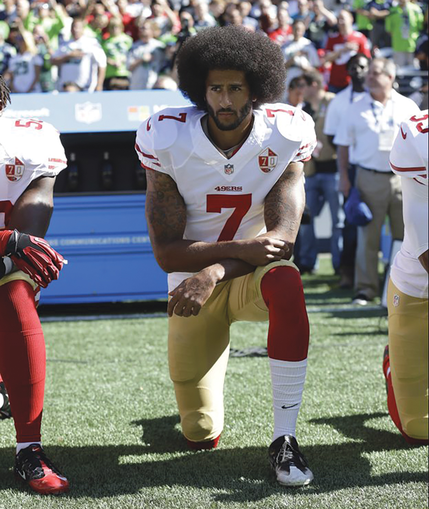 """FILE- In this Sept. 25, 2016, file photo, San Francisco 49ers' Colin Kaepernick kneels during the national anthem before an NFL football game against the Seattle Seahawks, in Seattle. Kaepernick has a new deal with Nike, even though the NFL does not want him. Kaepernick's attorney, Mark Geragos, made the announcement on Twitter, calling the former 49ers quarterback an """"All American Icon"""" and crediting attorney Ben Meiselas for getting the deal done. (AP Photo/Ted S. Warren, File)"""