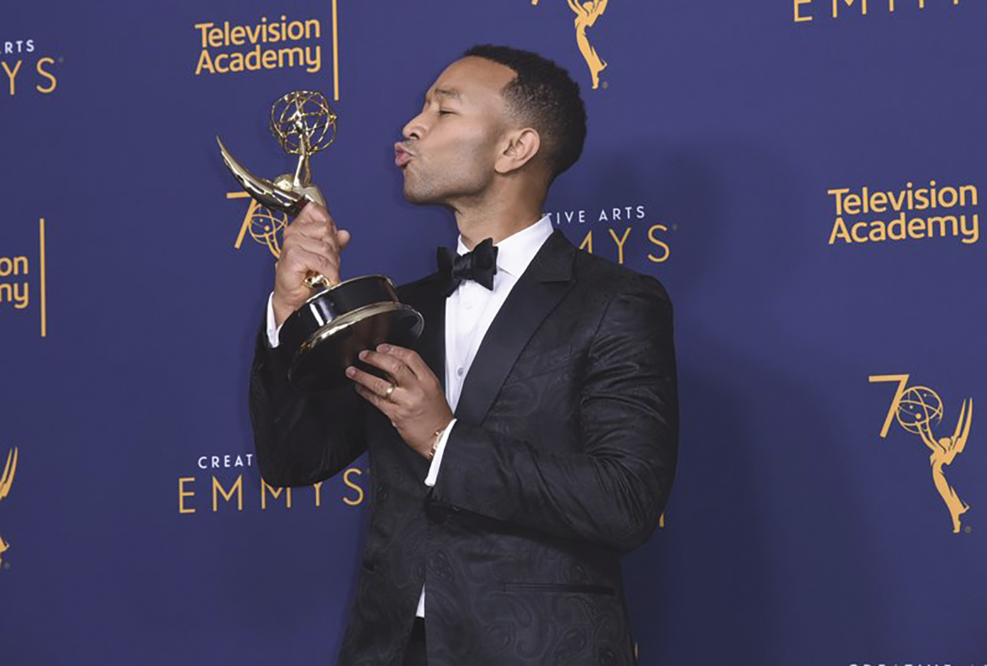 """John Legend, winner of the award for outstanding variety special for """"Jesus Christ Superstar Live in Concert,"""" poses in the press room during Night 2 of the Creative Arts Emmy Awards at The Microsoft Theater on Sunday, Sept. 9, 2018, in Los Angeles. (Photo by Richard Shotwell/Invision/AP)"""