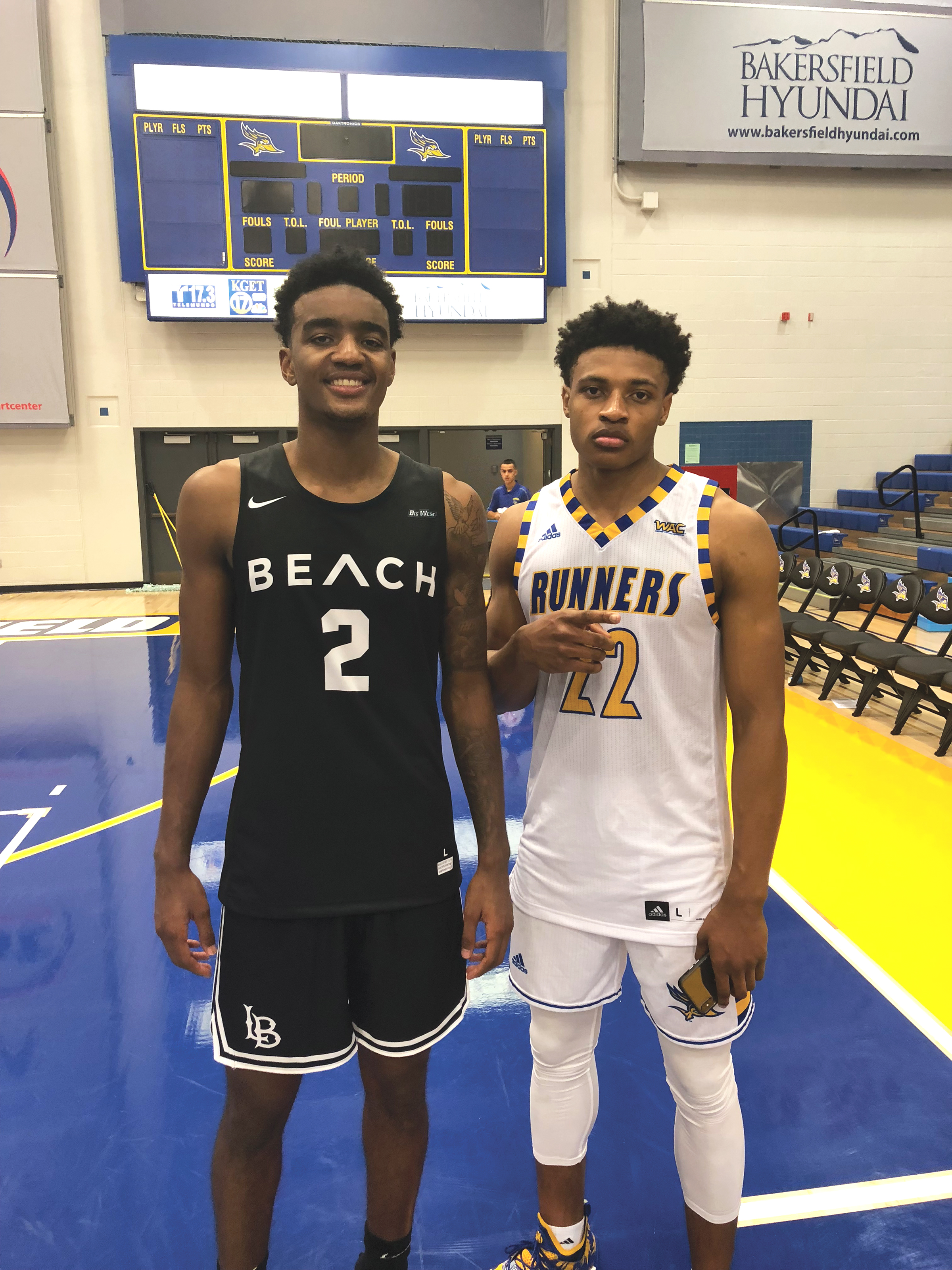 Local products Jordan Roberts (left) and Justin McCall (right) share a moment after Roberts Long Beach State basketball team edged out McCall's Cal State Bakersfield team 73-70. (Bakersfield News Observer photo)
