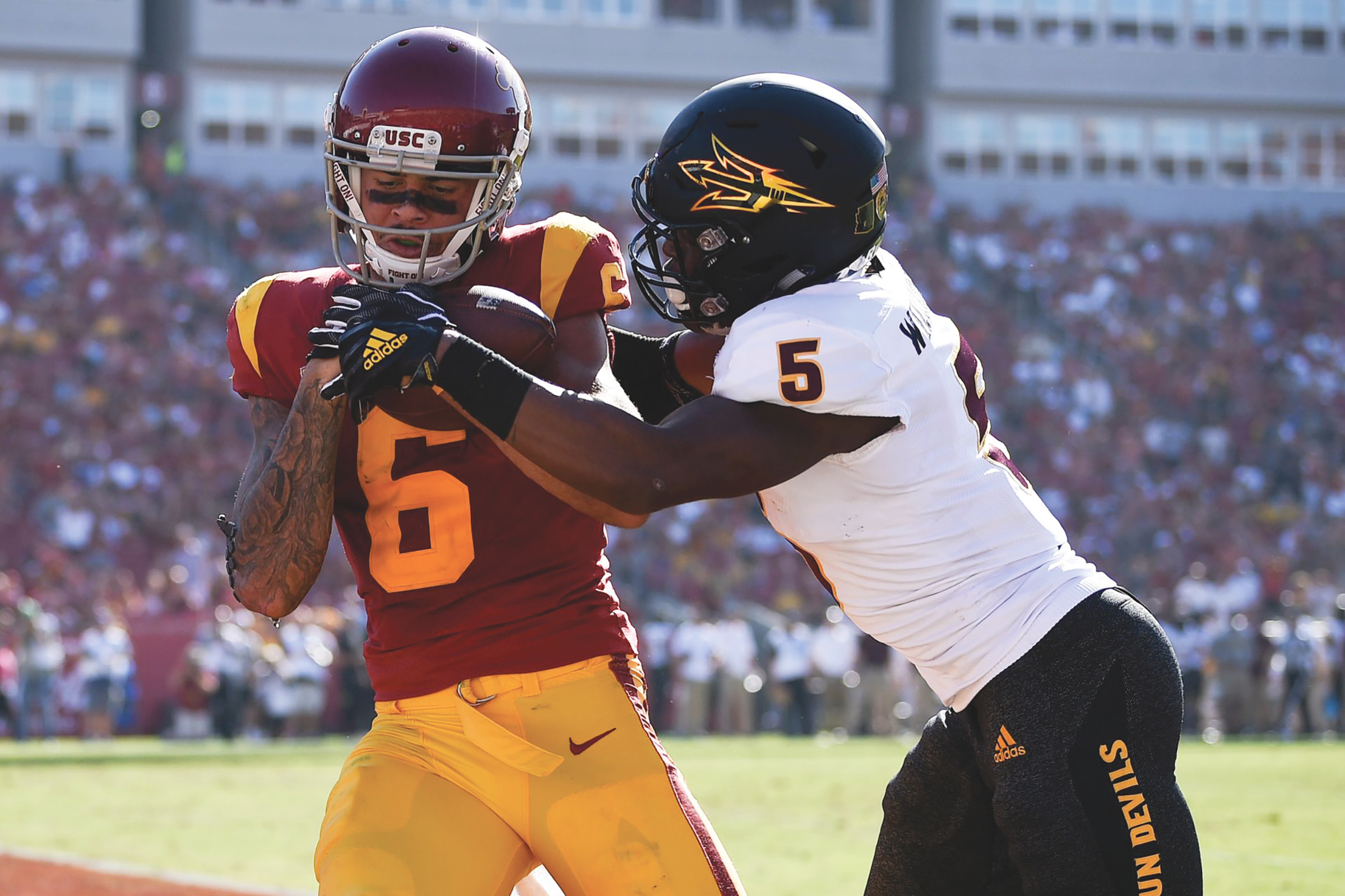 Southern California Trojans wide receiver Michael Pittman Jr. (6) catches a touchdown pass while Arizona State Sun Devils defensive back Kobe Williams (5) defends during the second half at Los Angeles Memorial Coliseum. (Kelvin Kuo-USA TODAY courtesy photo)