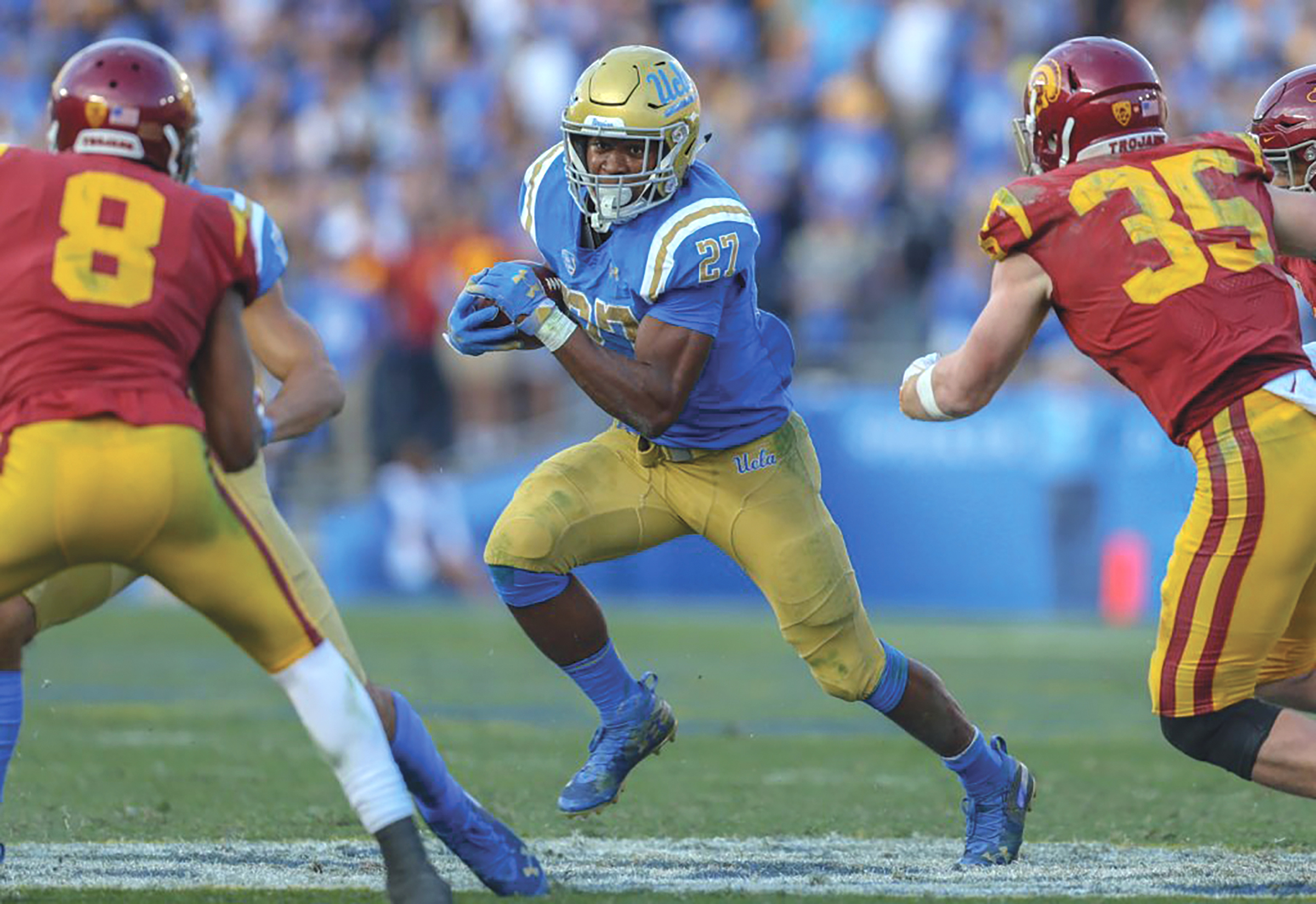 UC Davis Transfer Joshua Kelley with one of his school record 40 carries. (theathletic.com courtesy photo)