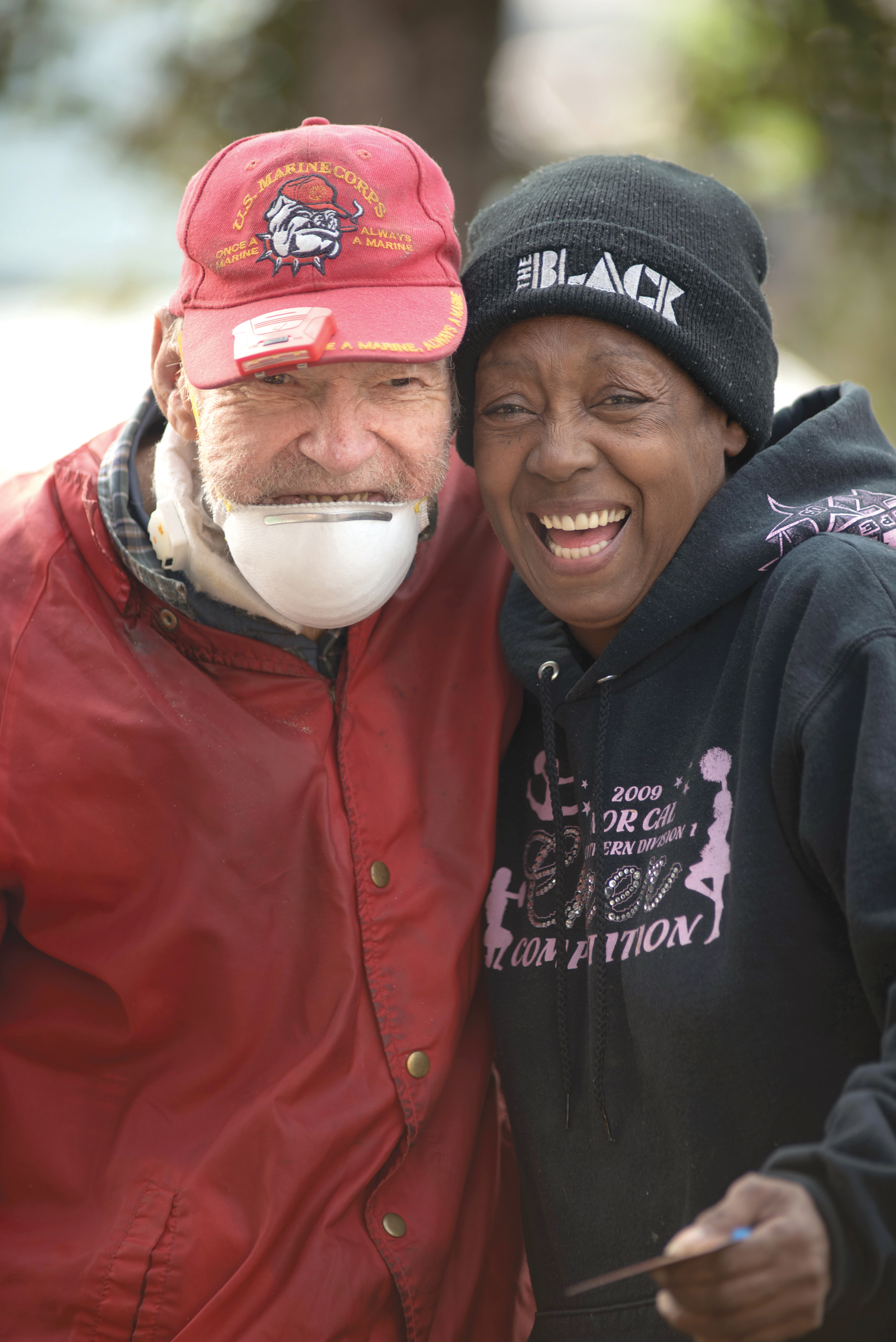 Sharon Cooke from Bethel AME Church in Chico, CA gives a hug to Robert Miller who lost his home in the Camp Fire. For the last three weeks, Northern California residents have come together to assist the thousands of people affected by the wildfire in Butte County, just 120 miles north of Sacramento. (OBSERVER photo by Robert Maryland)