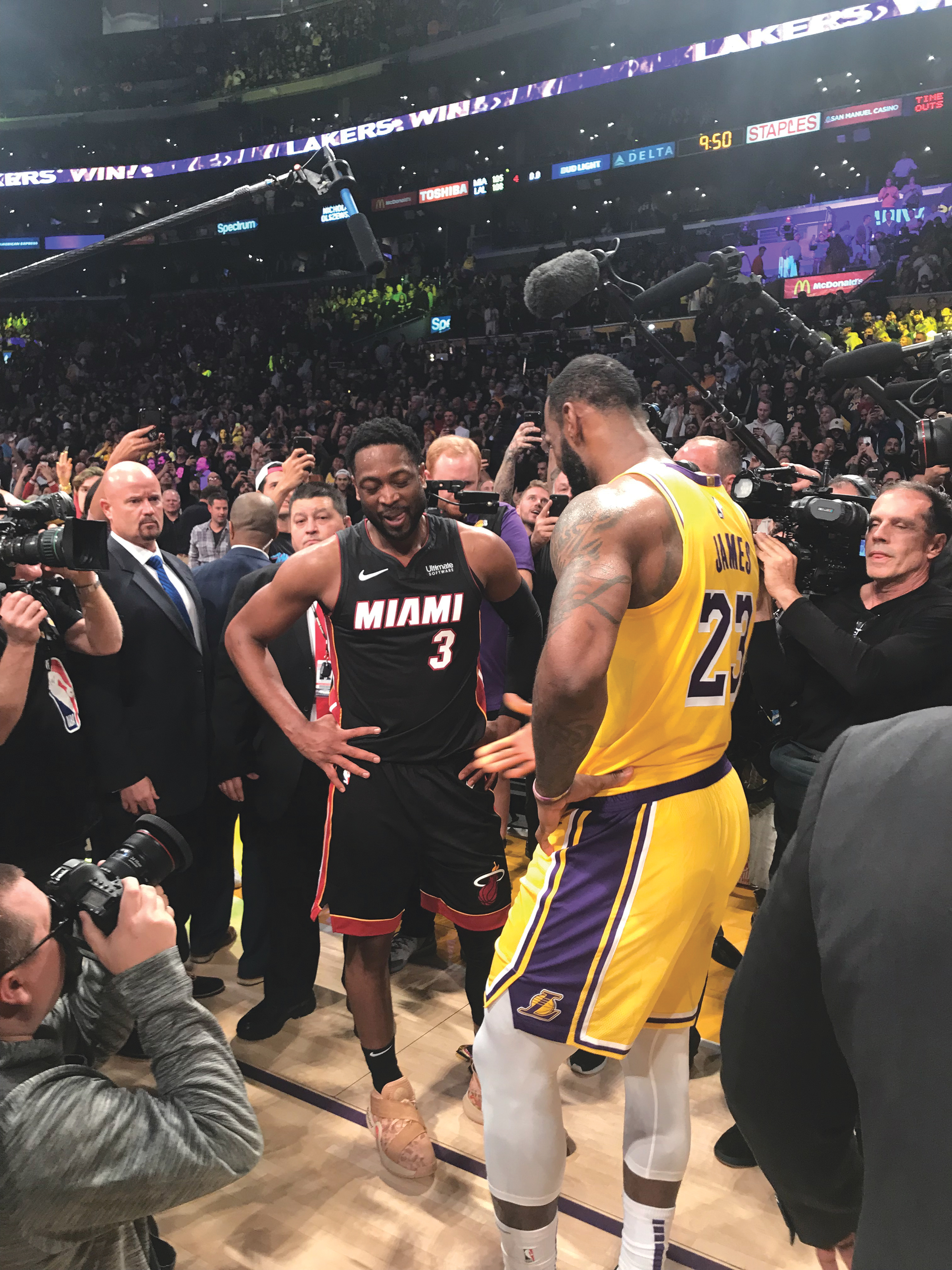 LeBron James and Dwayne Wade share a moment after Wade's last game against LeBron and the Lakers in Staples Center. (Cam Buford photo)