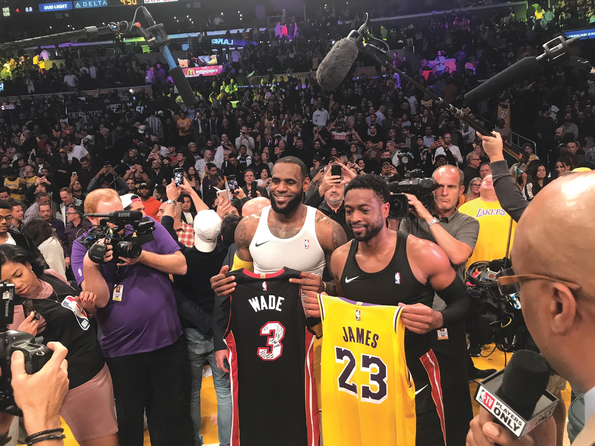 LeBron James and Dwayne Wade exchange jerseys after Wades final game at the Staples Center post game. (Cam Buford photo)