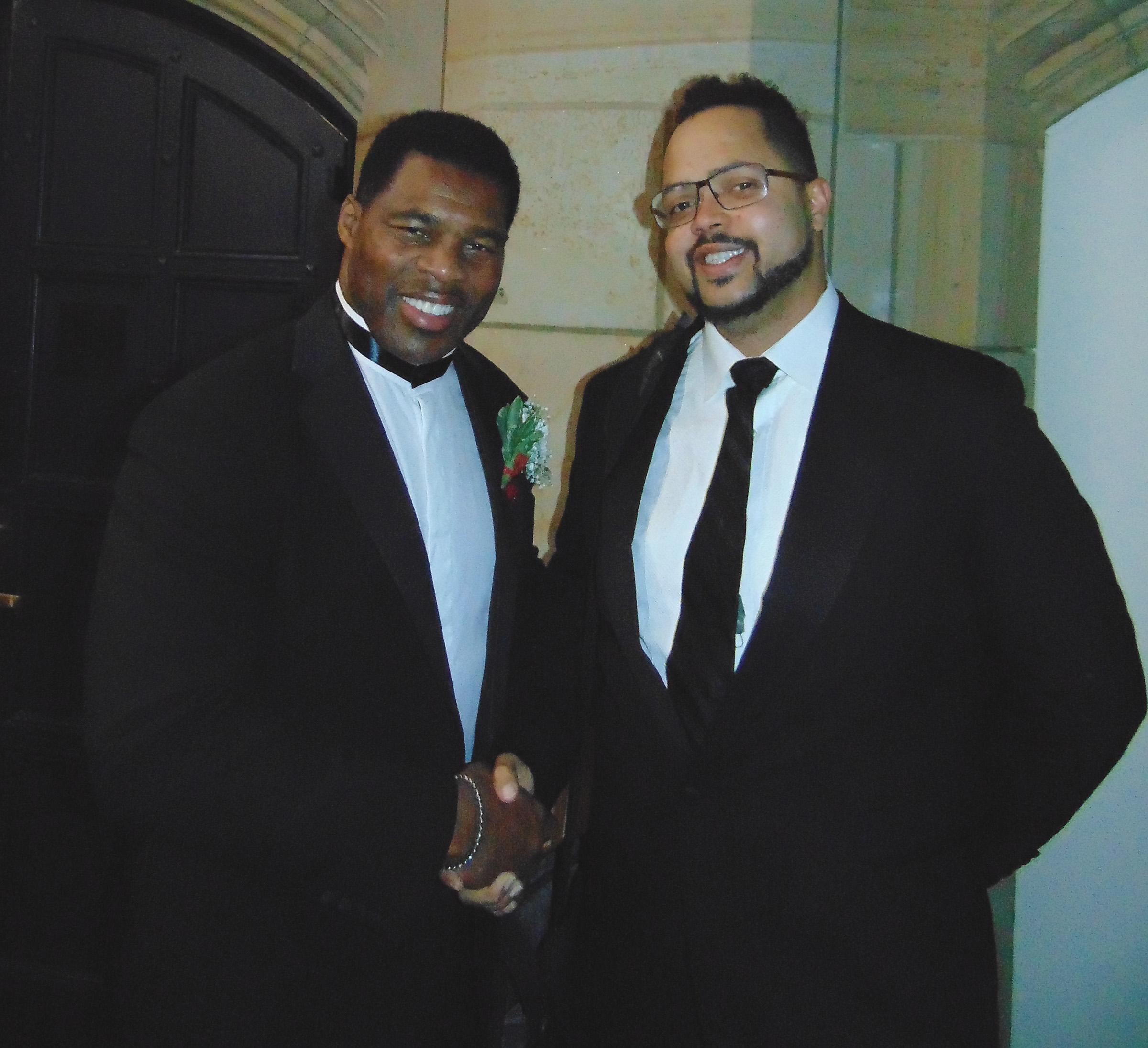 Walter Camp Alumni- Herschel Walker (L) shares a moment with Nicholas Heath. (Earl Heath photo)