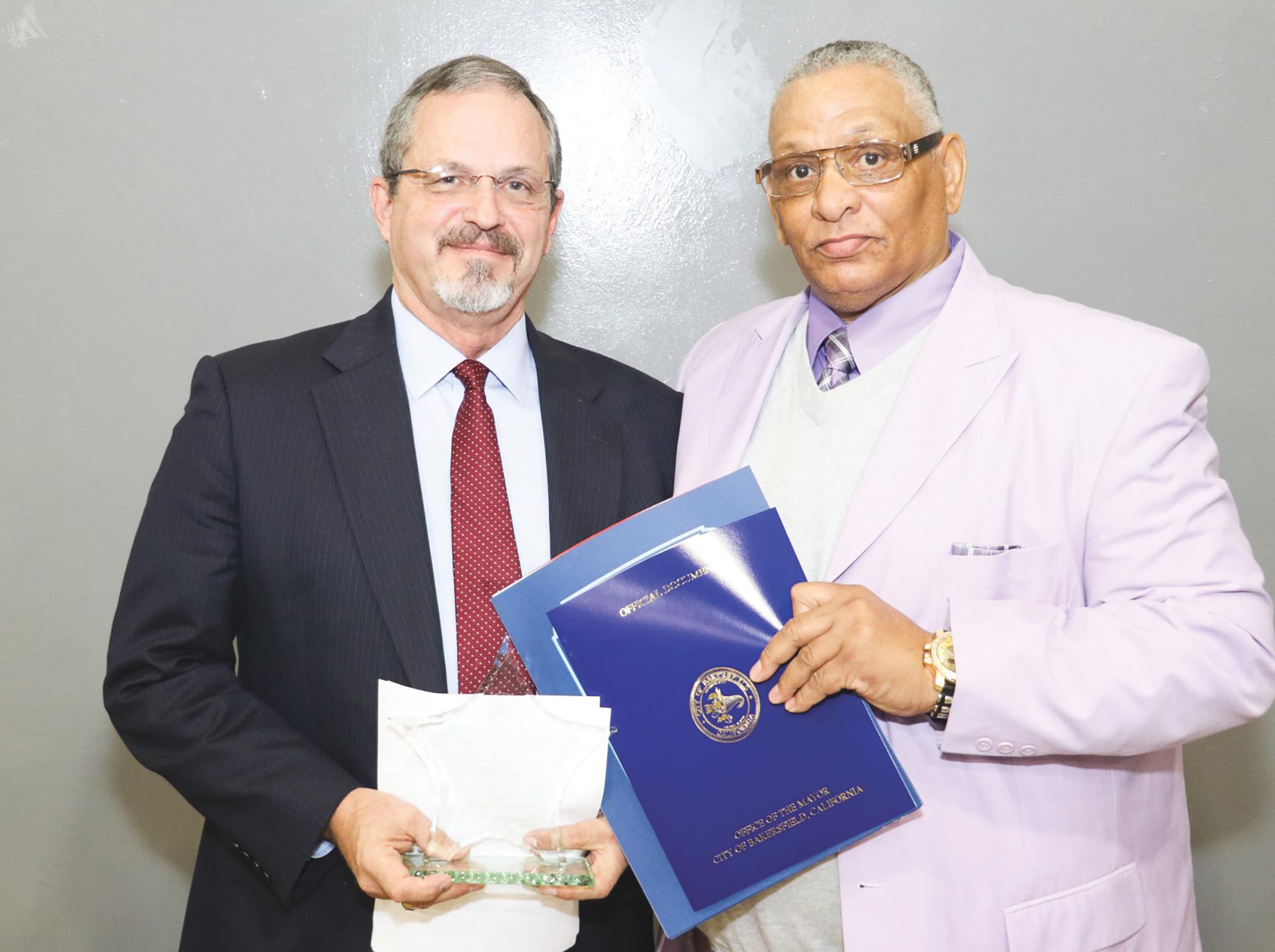 The Honorable Judge Stephen Schuett (L) accepting the Rev. Martin Luther King Jr. Mayor Harvey Hall Visionaries Award. (Carrington Prichett photo)