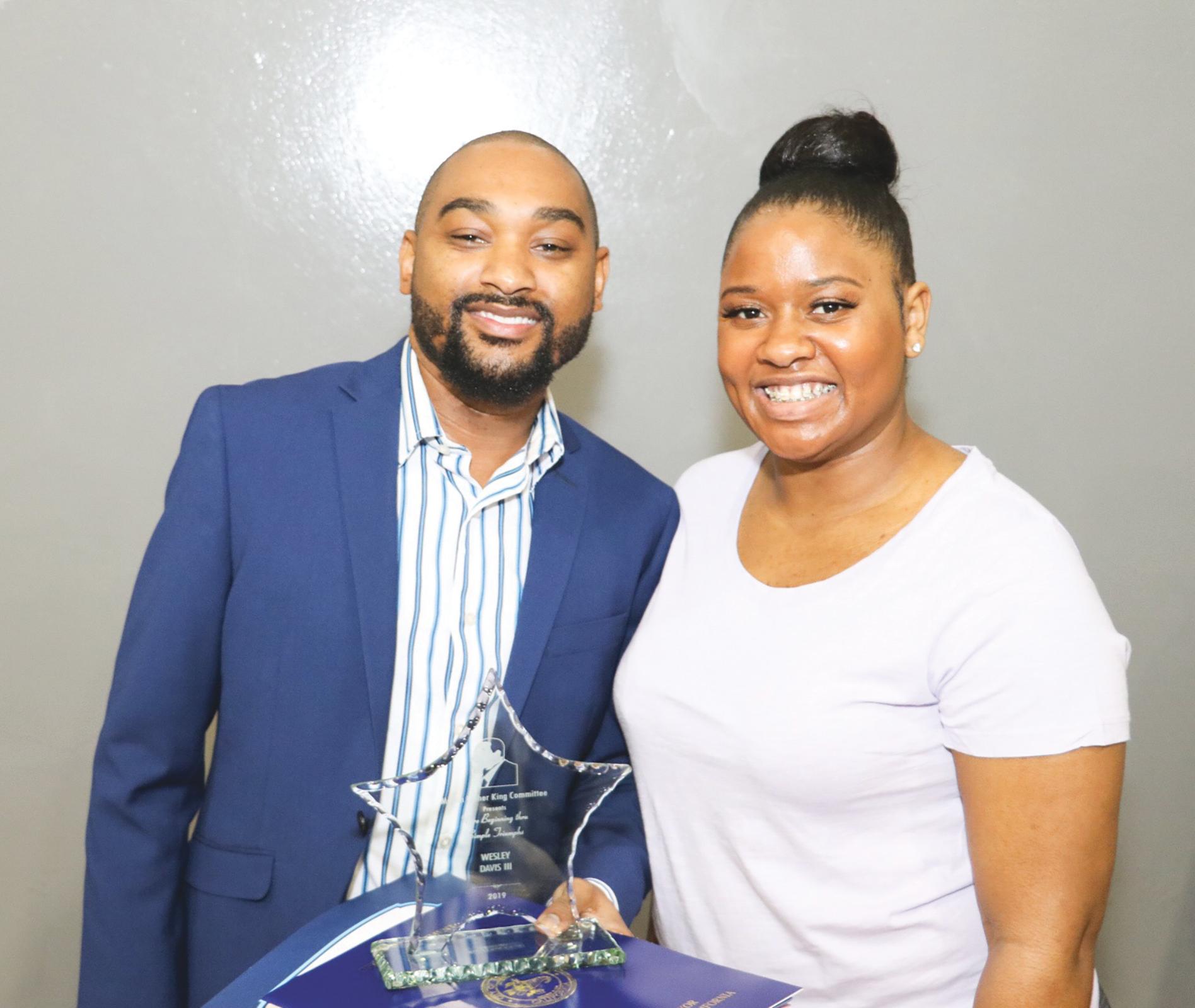 Wesley Davis III (L) accepting the Rev. Martin Luther King Jr. & Stephanie W. Campbell-Chatman Community Service Award. (Carrington Prichett photo)