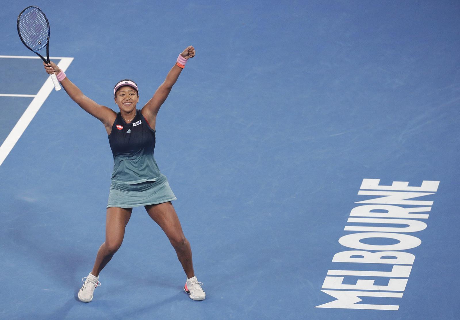 Japan's Naomi Osaka celebrates after defeating Karolina Pliskova of the Czech Republic in their semifinal at the Australian Open tennis championships in Melbourne, Australia, Thursday, Jan. 24, 2019. (AP Photo/Aaron Favila)