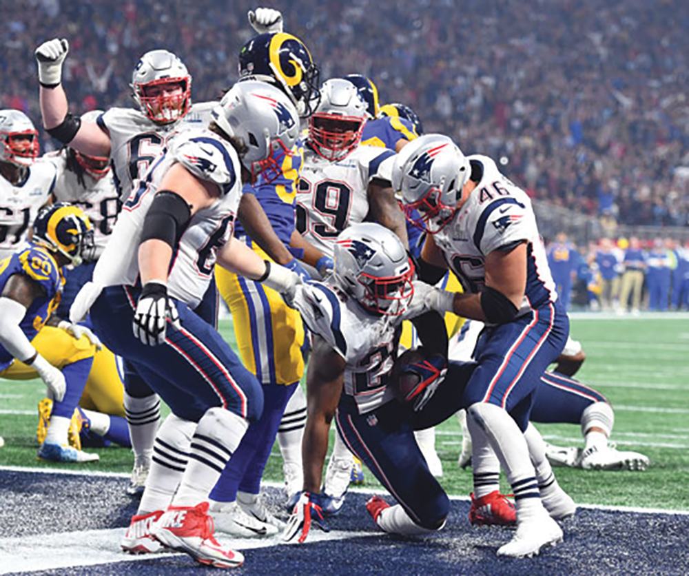 Sony Michel's teammates are ready to celebrate his go ahead TD in SBLIII. (Bing Photos)