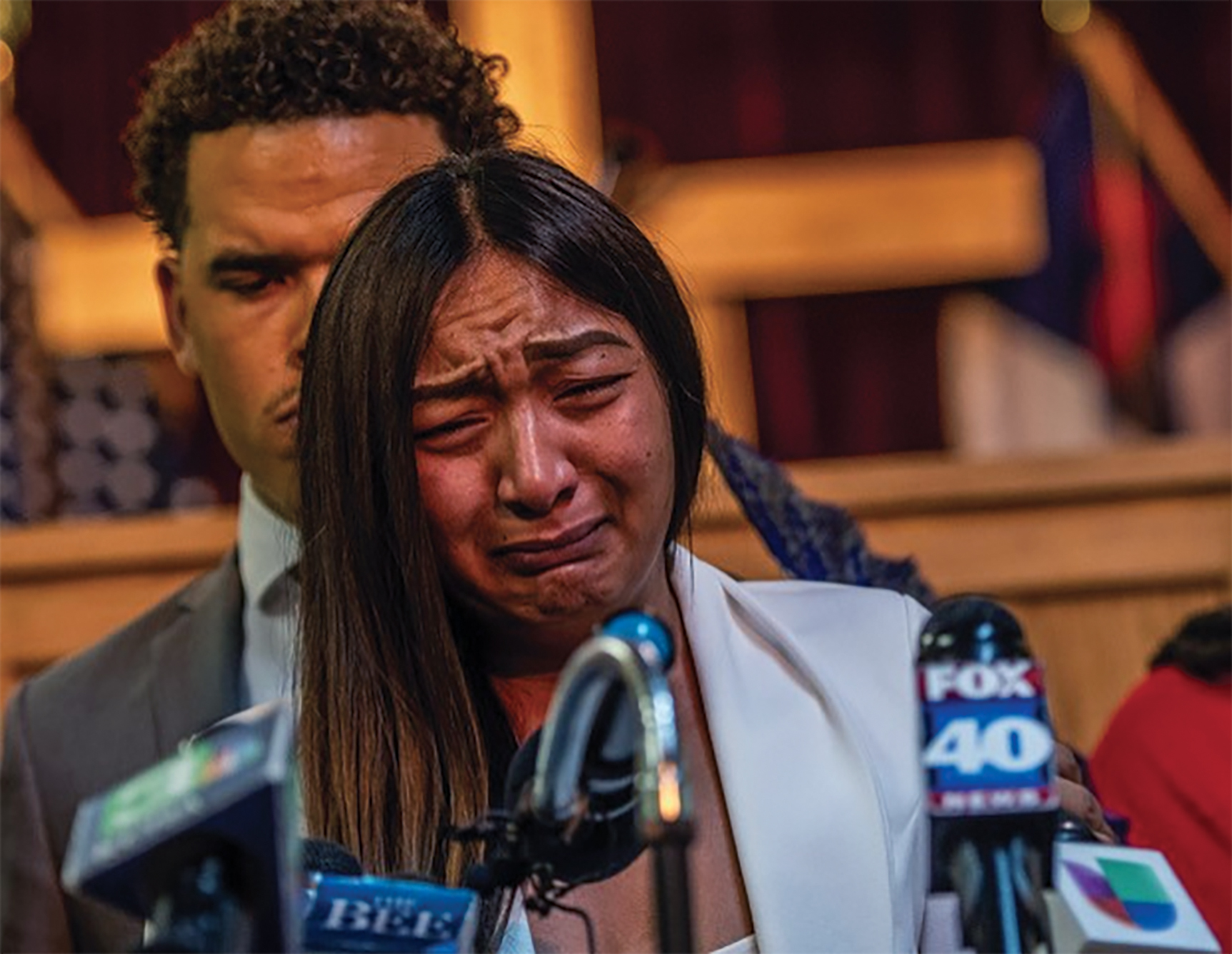 Salena Manni gives a tearful statement in response to the DA's announcement of not charging police officers in the shooting of the father of her children, Stephon Clark. (Photo by Russell Stiger/CBM)