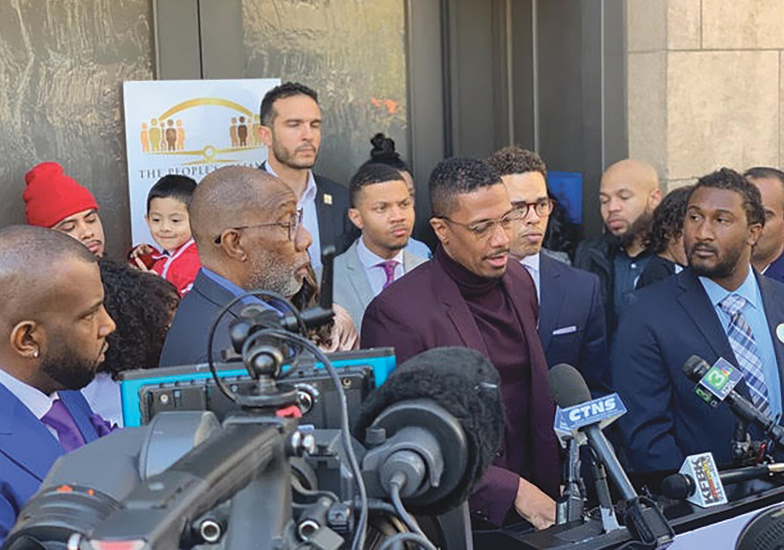 Nick Cannon standing with The People's Alliance For Justice Founder Rev. Shane Harris and supporters for AB 329, a bill aimed to reduce police use of force. (CBM courtesy photo)