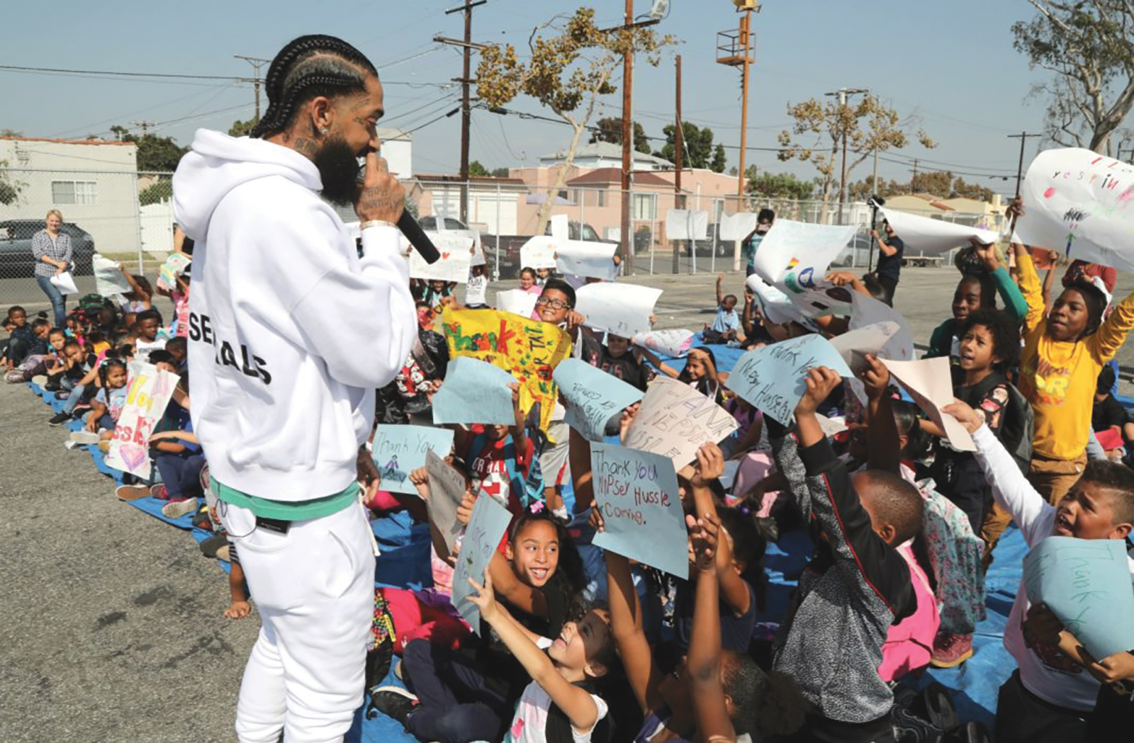 Nipsey Hussle at a basketball court refurbishment in October in L.A. (Jerritt Clark/Getty Images)