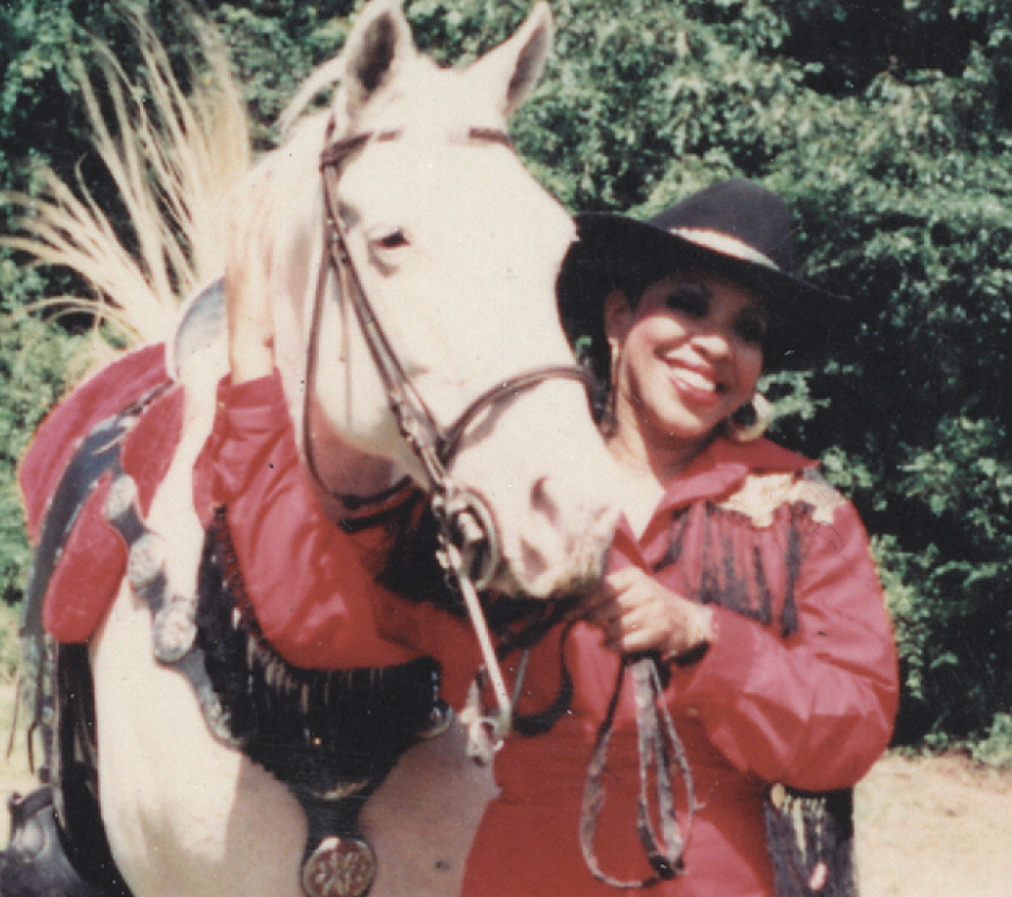 """Barbara Love is the local organizer for the Bill Pickett Invitational Rodeo – but she's better known as """"Miss Kitty,"""" pictured here in a TSD file photo with her horse Silver."""