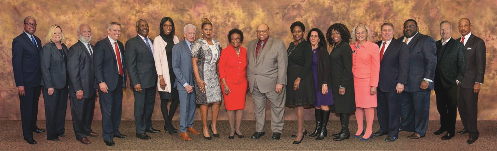 "Pictured from left: Jéan Wilson; Leticia Marquez; Emerson Thompson; John Crossman; Jerry Demings; A. Noni Holmes-Kidd; William ""Bud"" Kirk; Lindsay Greene; Arthenia Joyner; LeRoy Pernell; Faye Allen; Christina Redman; Roberta Walton; Ava Doppelt; Gary Salzman; Christopher Monts; Buddy Dyer; and Donald Henderson. Not Pictured: John Davis."