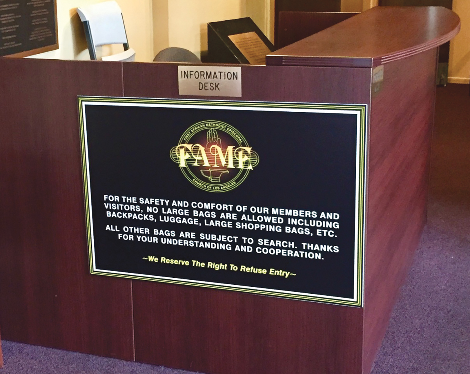 Photo By CBM: First African Methodist Episcopal Church FAME, the oldest church in Los Angeles founded by African Americans in 1872 posted signage at their information desk a few years ago because of attacks on houses of worship. Rev. J Edgar Boyd is the pastor of this church.