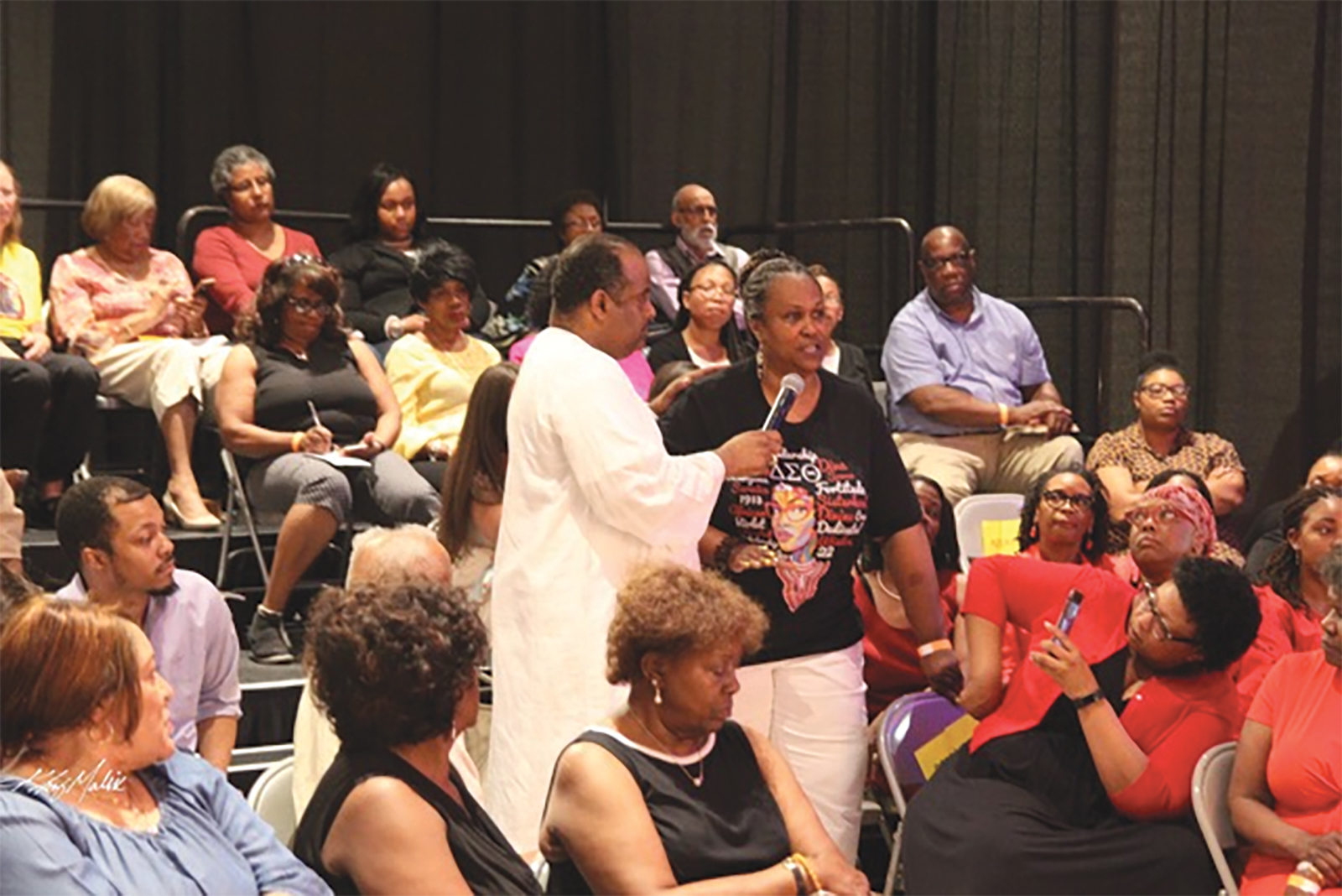 Photo By: Khiry Malik, Roland Martin takes questions from a town hall attendee directed to the panelist.