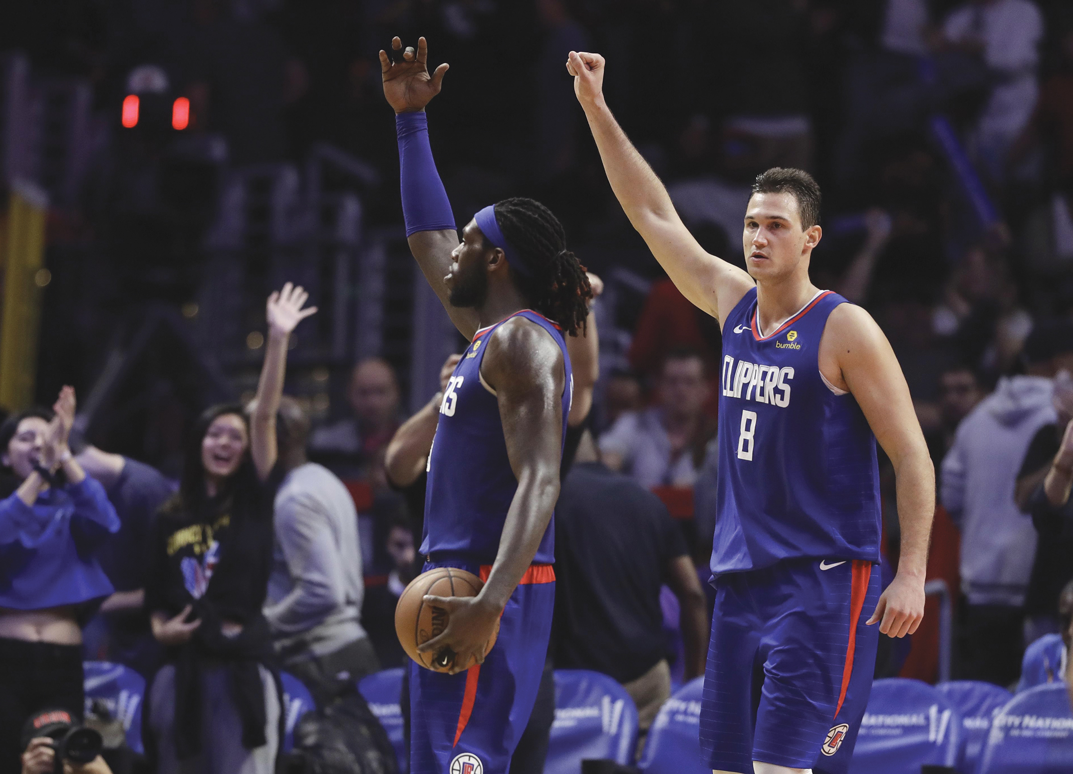Los Angeles Clippers' Montrezl Harrell, left, and Danilo Gallinari, celebrate after a 112-107 overtime win over the Memphis Grizzlies earlier in the season, in Los Angeles. (Marcio Jose Sanchez / Associated Press)