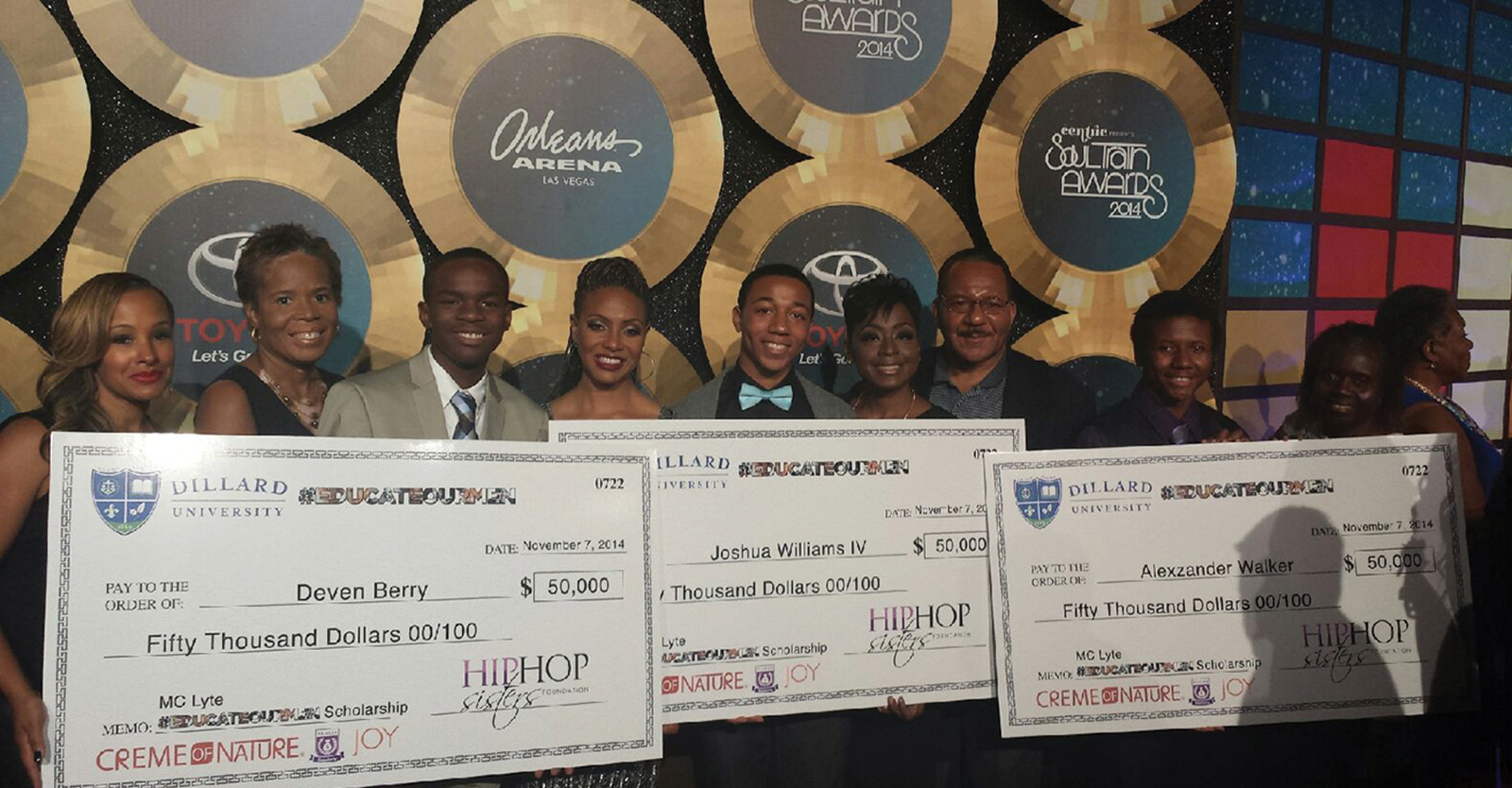 MC Lyte stands with scholarship recipients. (Courtesy Hip Hop Sisters Network)