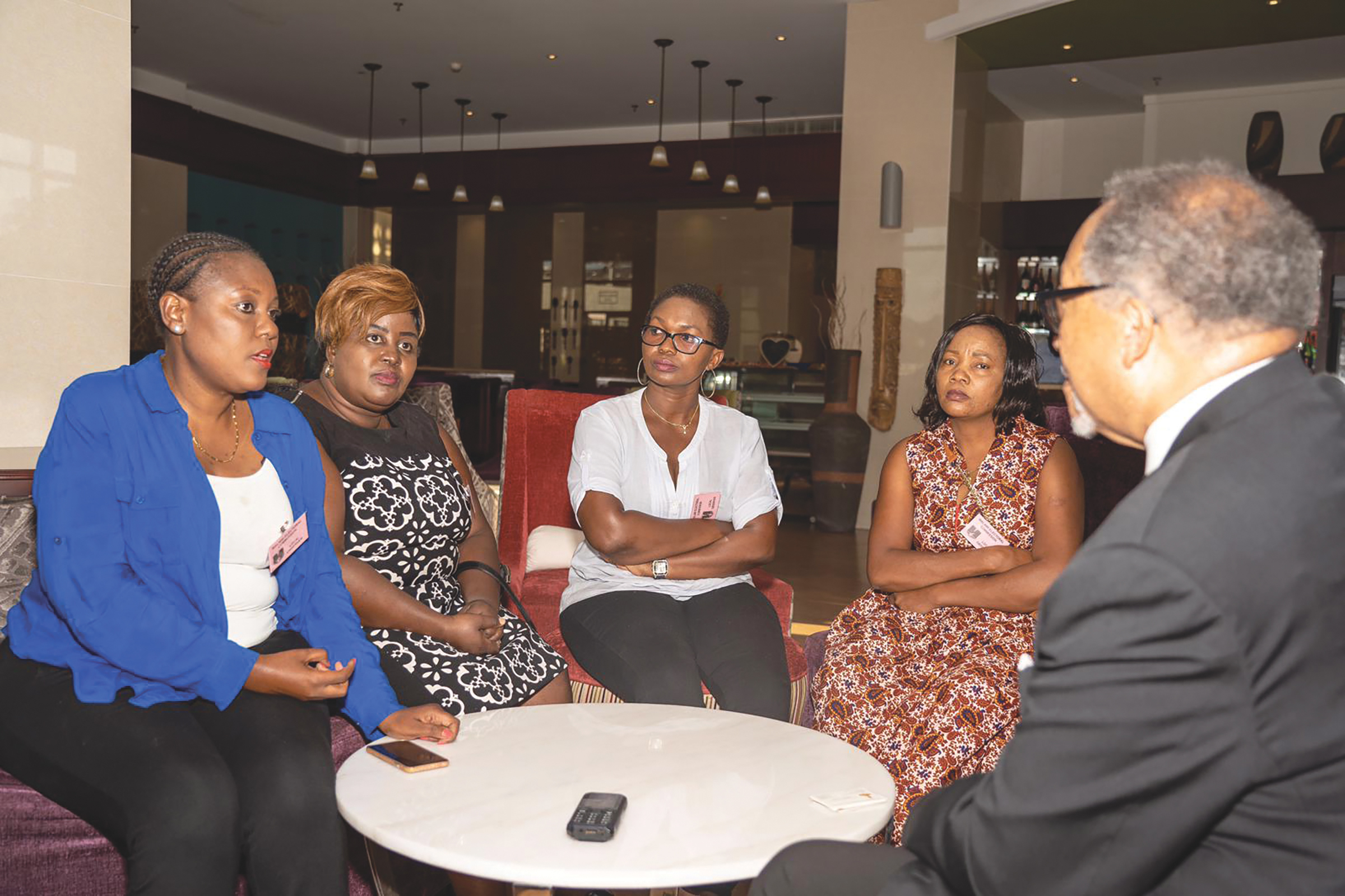 NNPA President and CEO, Dr Benjamin F. Chavis, Jr., (far right) invited Kettie Kamwangala (far left) and other Malawian women leaders for an open discussion while the ballots were being counted after a historic voter turnout across Malawi.