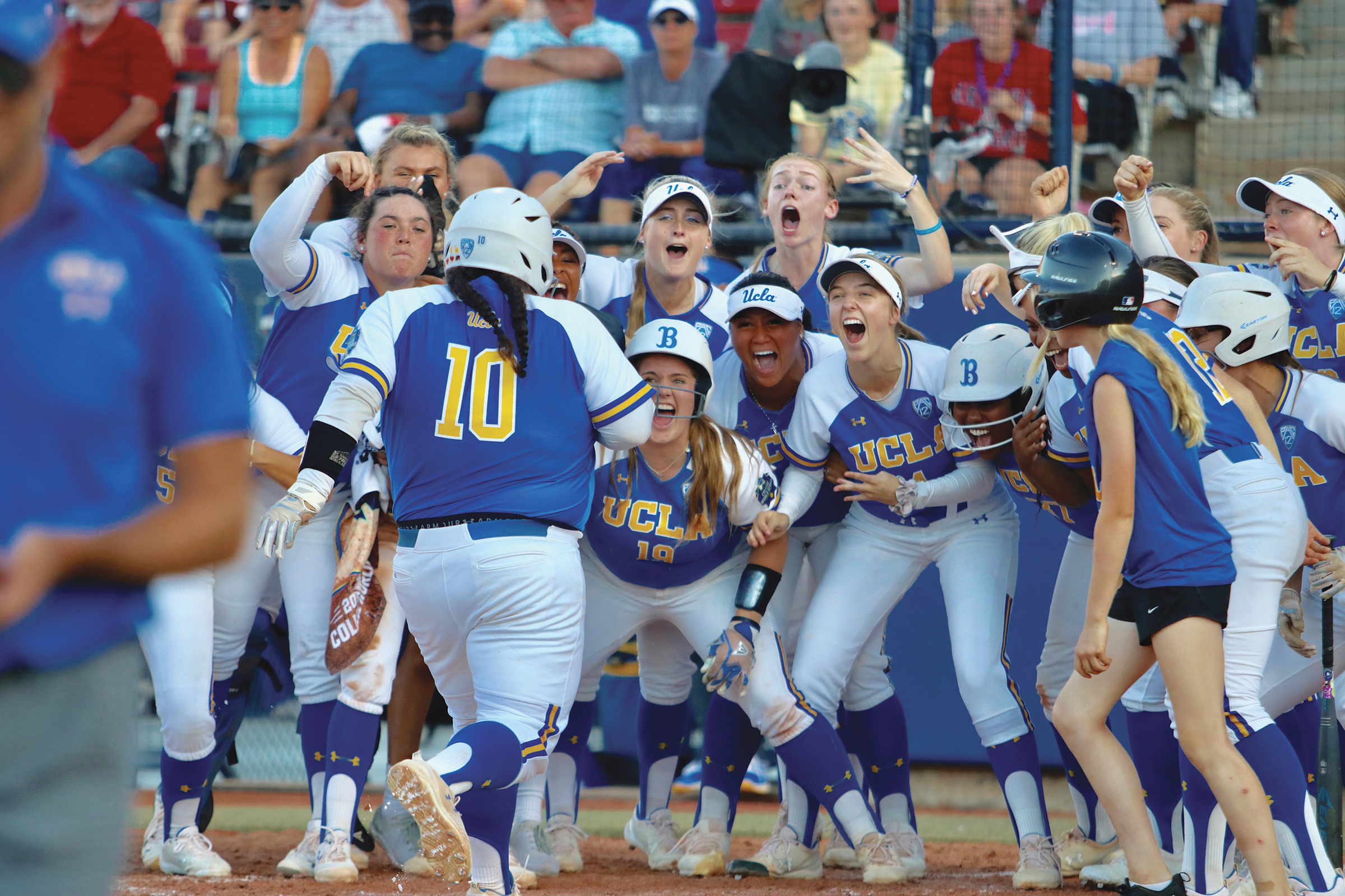 Malia Quarles (10) of Cerritos is greeted by teammates after hitting a go ahead homer during WCWS. (UCLA courtesy photo)