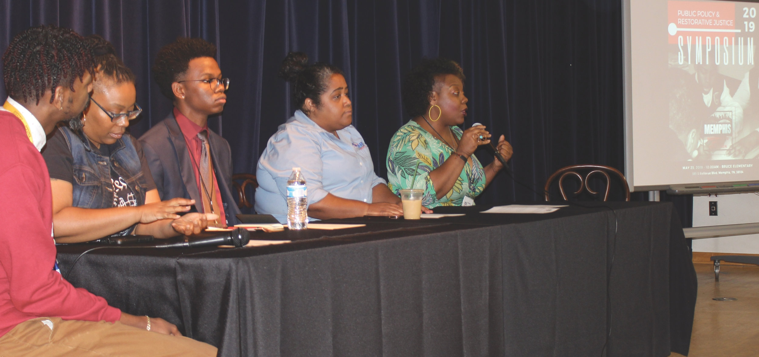 Empowerment expert Pametria Brown (right) shares a reflection as part of a symposium panel that also featured (l-r) Archie Moss Jr., Shahidah Jones, Cameron Jones and state Sen. Raumesh Akbari, who was the moderator. (Photo: George W. Tillman Jr.)