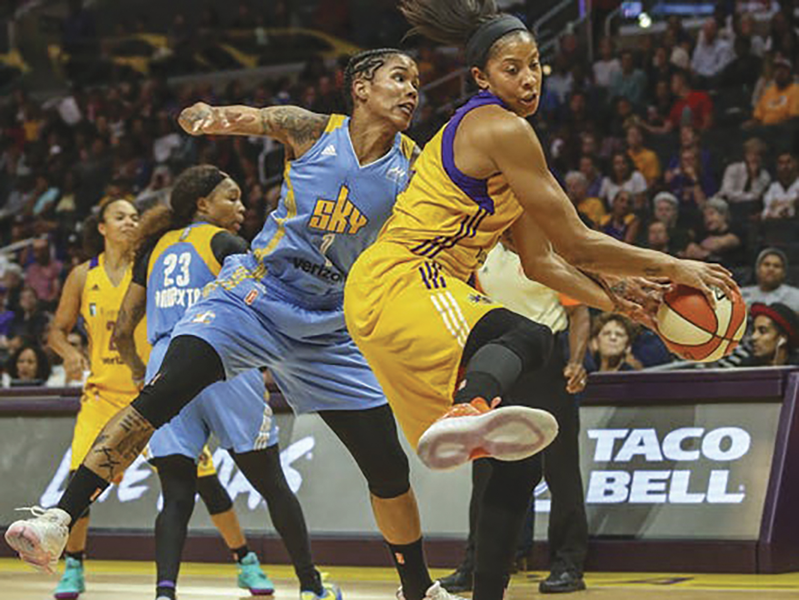 Los Angeles Sparks forward Candace Parker, right, and Chicago Sky forward Tamera Young reach for the ball during the second half of Game 2 of a WBNA basketball semifinal in Los Angeles on Friday, Sept. 30, 2016. The Sparks won 99-84. (AP Photo/Ringo H.W. Chiu)