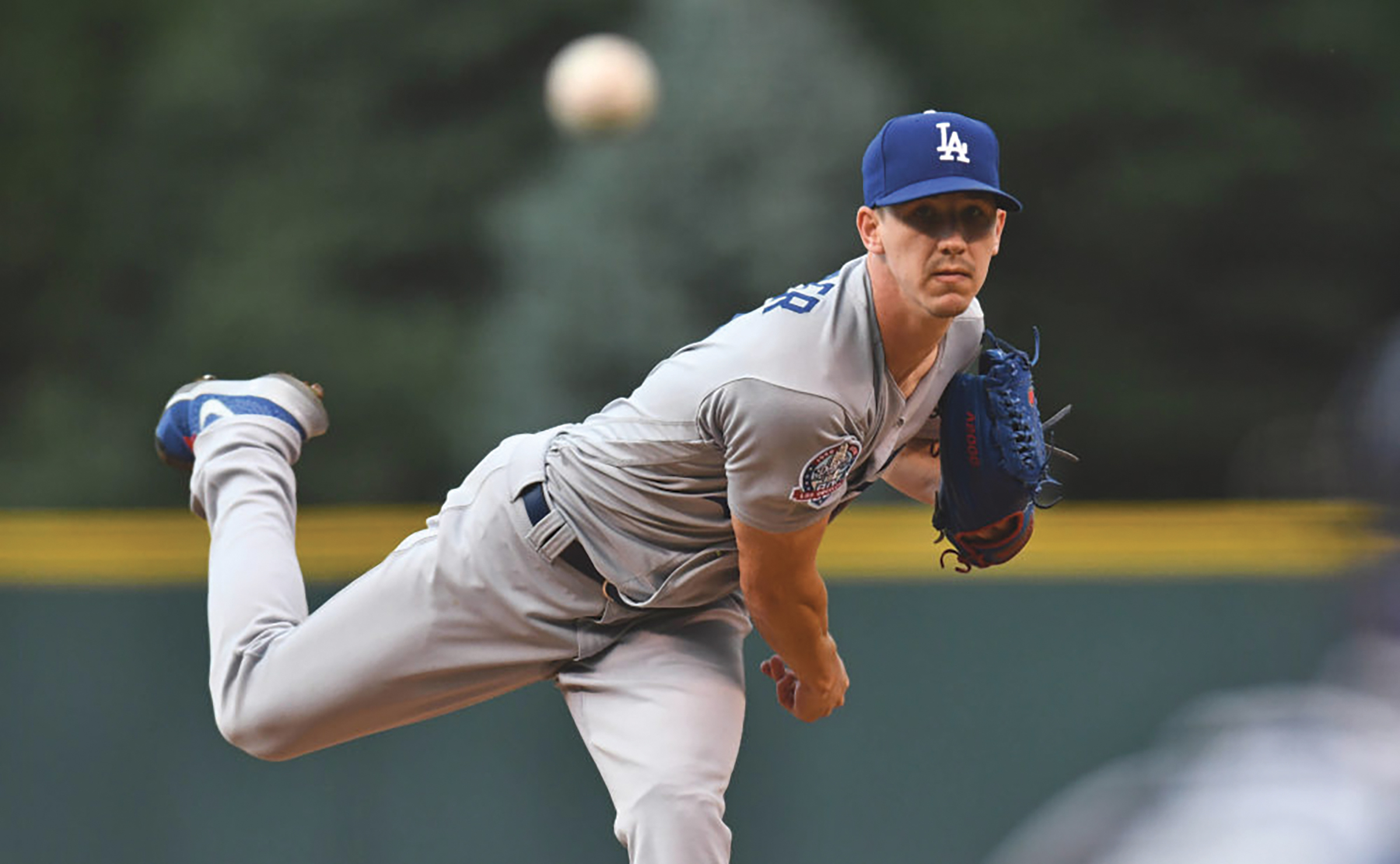 Los Angeles Dodgers starting pitcher Walker Buehler (21) delivers a pitch in the first inning against the Colorado Rockies at Coors Field. (Ron Chenoy-USA TODAY Sports)