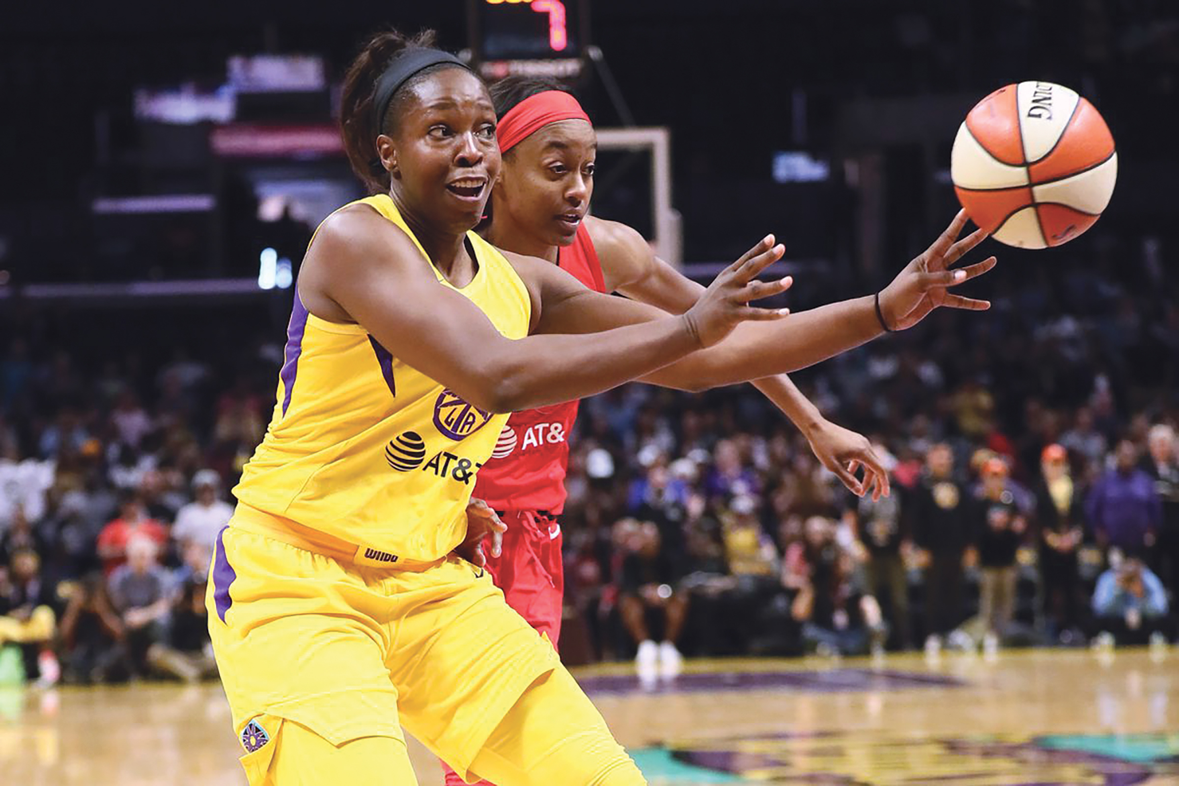 Chelsea Gray tosses one of her 13 assists on her way to a triple-double in the Sparks win over the Mystics. (Photo by Leon Bennett/Getty Images)