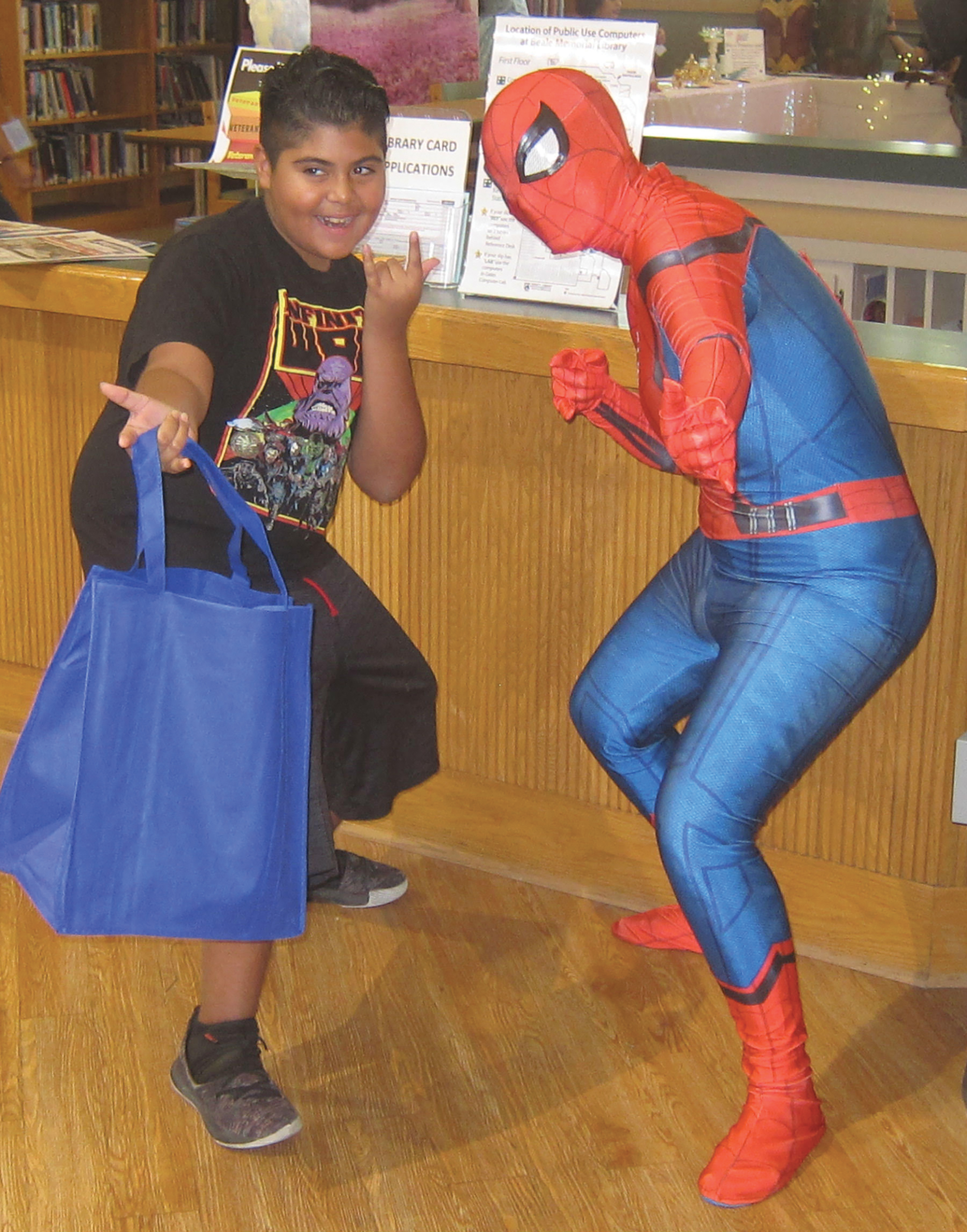 Children of Bakersfield got a chance to pose with their favorite comic book characters at the 2nd annual Beale Mini Con. (Courtesy Photo)