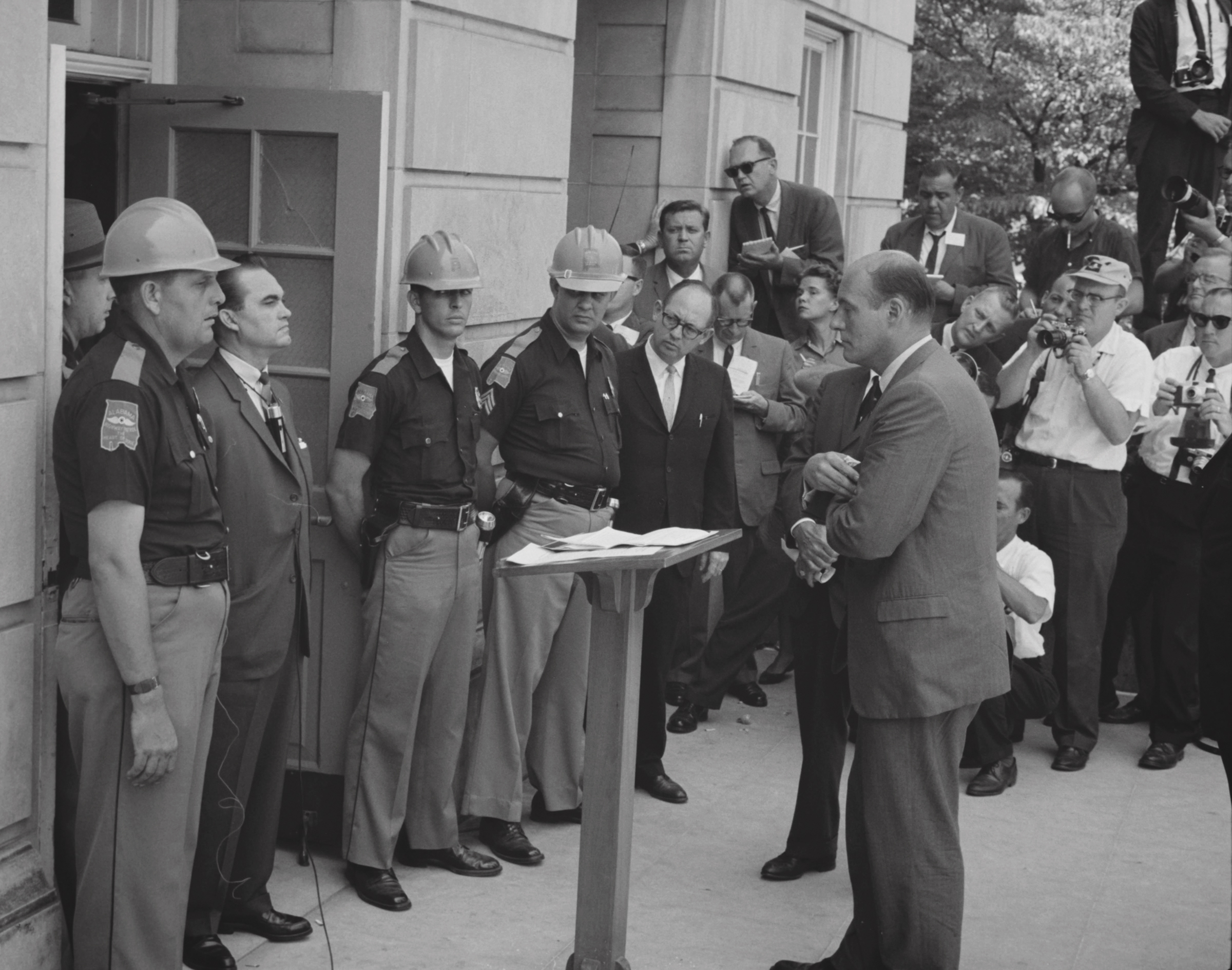 Attempting to block integration at the University of Alabama, Governor George Wallace stands defiantly at the door while being confronted by Deputy U.S. Attorney General Nicholas Katzenbach. (Photo: Warren K. Leffler, U.S. News & World Report Magazine [Public domain]/Wikimedia Commons)