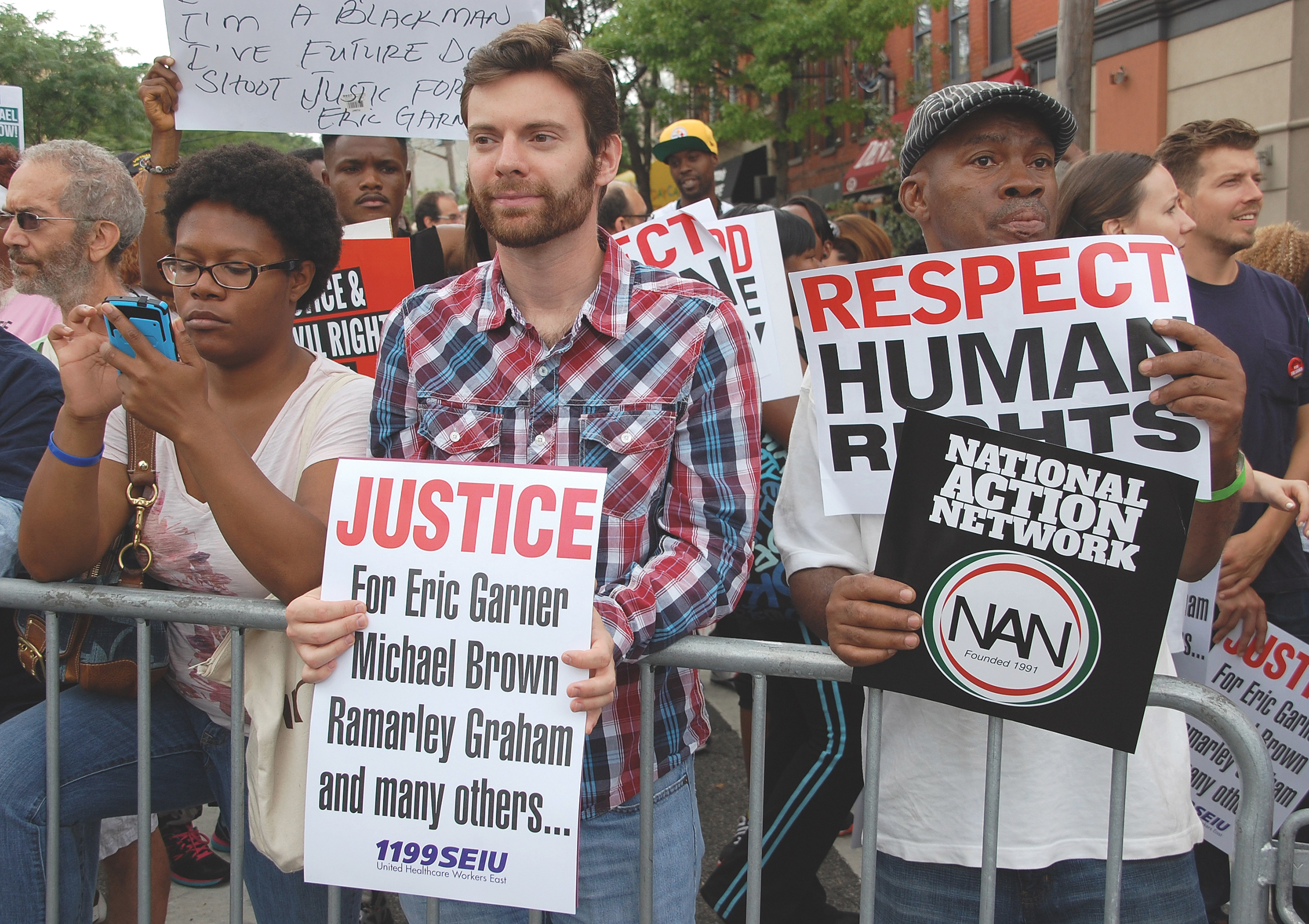 """STATEN ISLAND, N.Y. — Protesters at the """"We Will Not Go Back"""" march and rally called by Al Sharpton and the National Action Network to demand justice for the family of Eric Garner whose death was declared a homicide by the NYC Medical Examiner. Garner died on July 17, 2014 while being arrested by police. The ME ruled the cause of death was an illegal chokehold (applied by P.O. Daniel Pantaleo) and """"chest compression"""" - prompting civil rights advocates to organize this very large protest (approximately 4000 demonstrators). (Photo: Wikimedia Commons / Credit: """"Thomas Altfather Good"""".)"""