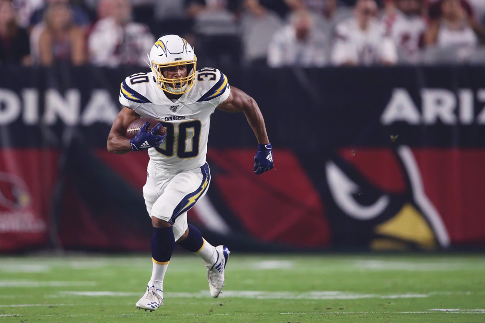 Austin Ekeler finds an opening against the Cardinals in the Chargers Pre-Season opener. (Courtesy Photo)