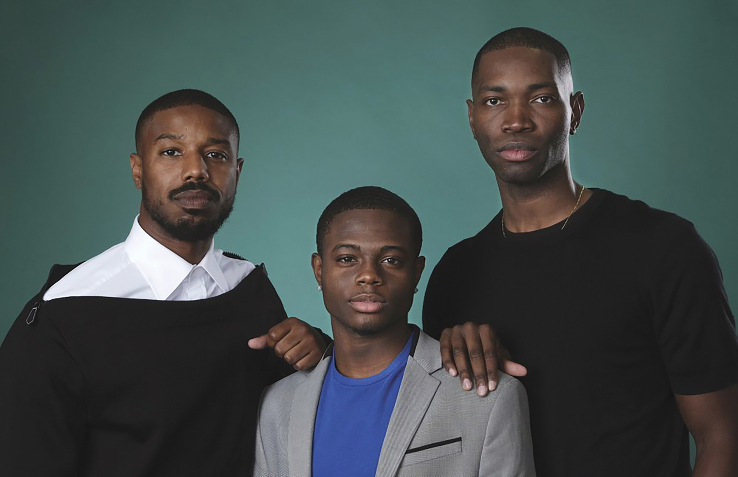 """Tarell Alvin McCraney, right, creator/executive producer of the OWN series """"David Makes Man,"""" poses with executive producer Michael B. Jordan, left, and cast member Akili McDowell for a portrait during the 2019 Television Critics Association Summer Press Tour at the Beverly Hilton, Friday, July 26, 2019, in Beverly Hills, Calif. (Photo by Chris Pizzello/Invision/AP)"""