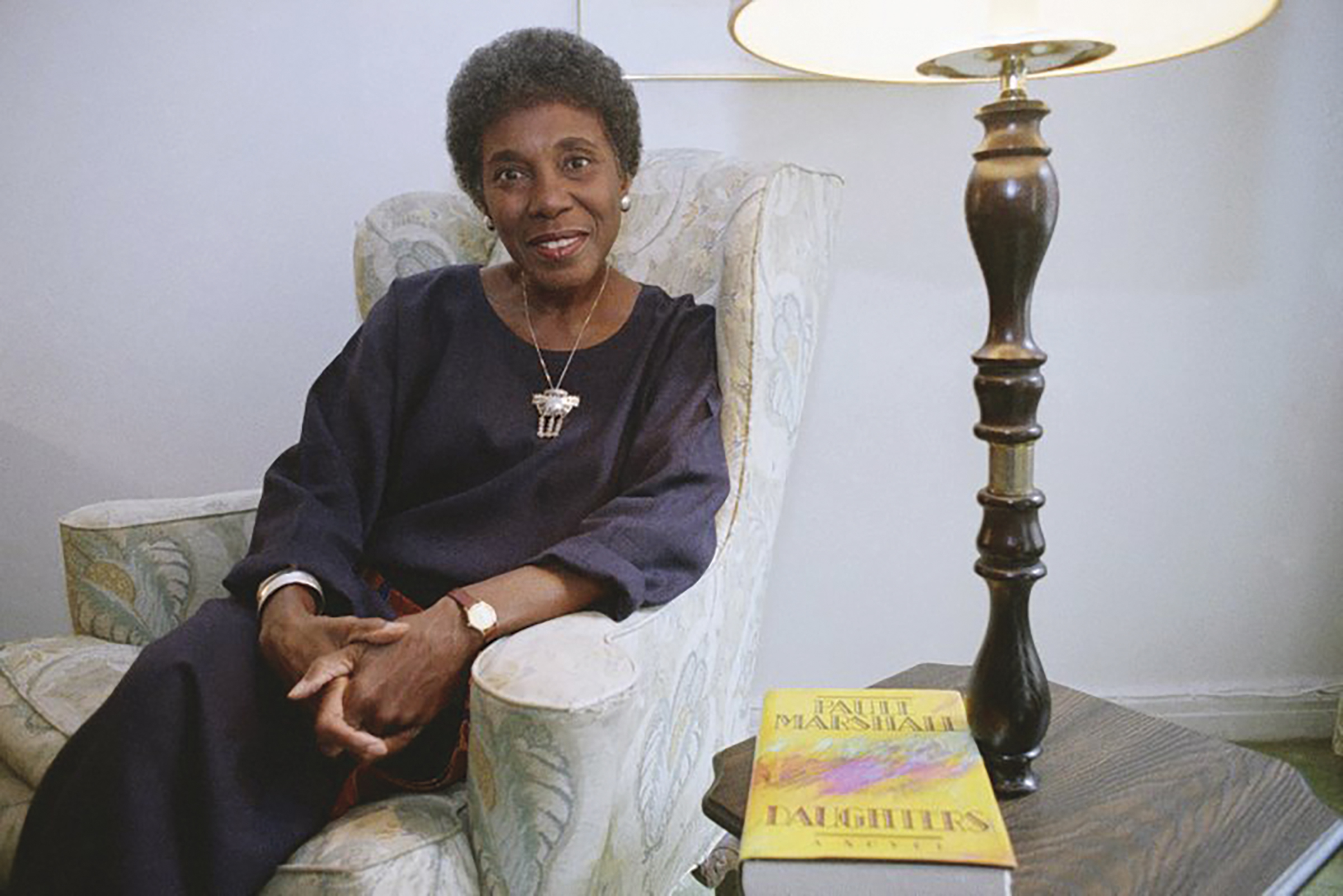 FILE - In this Nov. 22, 1991 file photo, author Paule Marshall poses during an interview, in New York. The acclaimed fiction writer has died at 90. Marshall's son, Evan K. Marshall, told The Associated Press that she died Monday, Aug. 12, 2019 in Richmond, Va. Marshall was an exuberant and sharpened storyteller who drew upon classic and vernacular literature and her mother's kitchen conversations for such fiction as