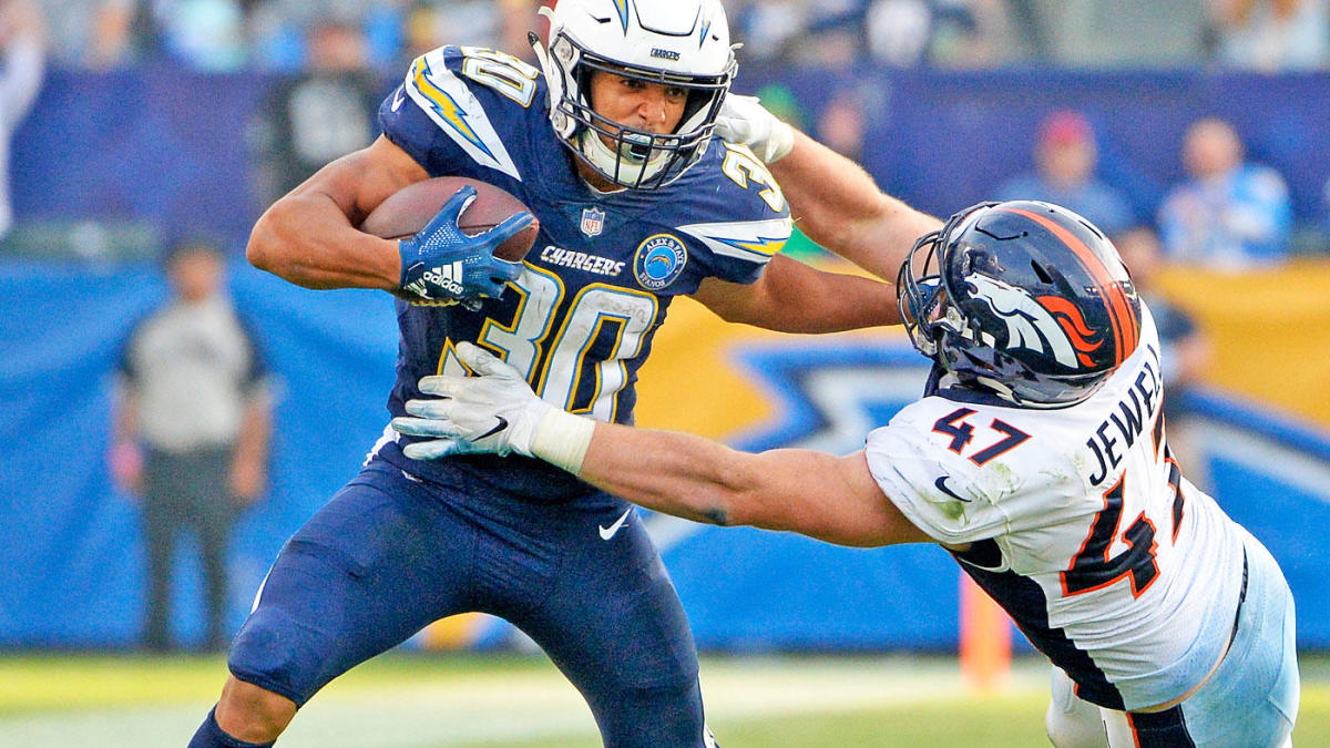 Austin Ekeler breaks a tackle against the Denver Broncos in 2018 (Credit: Bing Photos)