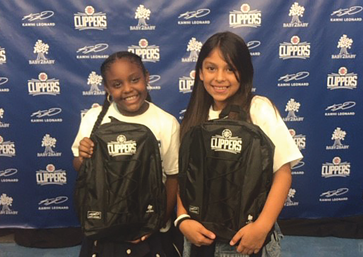 Happy children receiving Back Packs from Kawhi and the Clippers. (Photo Credit LA Clippers)