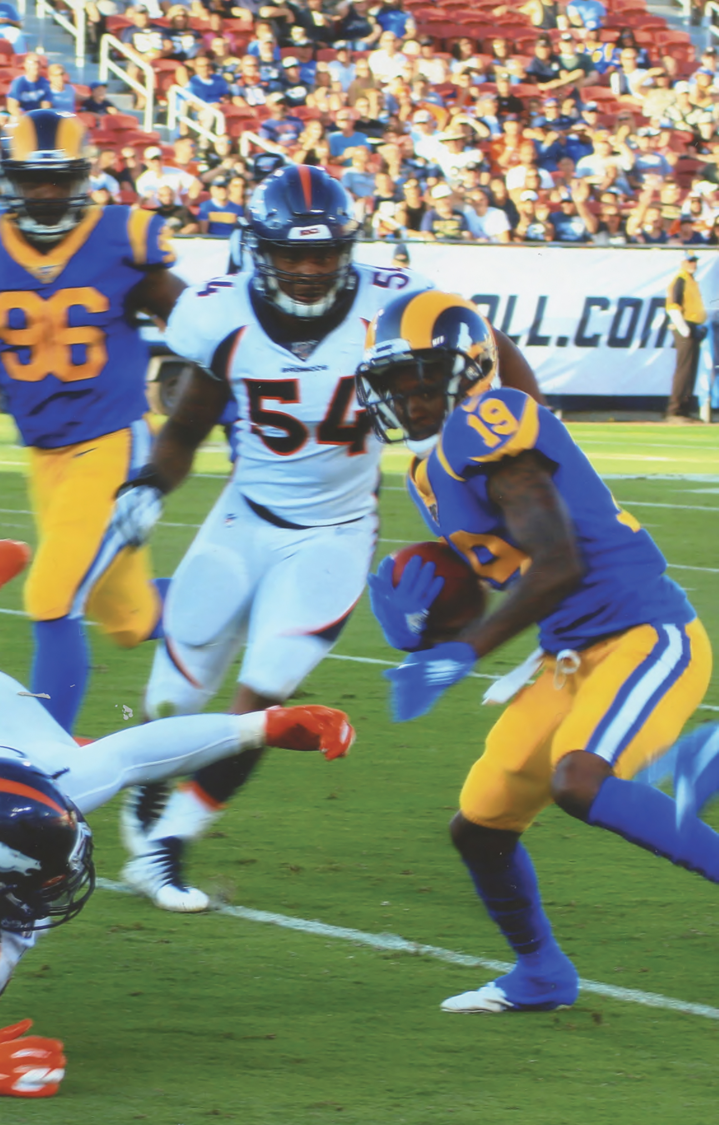 The LA Rams Jo jo Norton (19) returns a punt against Bronco's. (Earl Heath Photo)